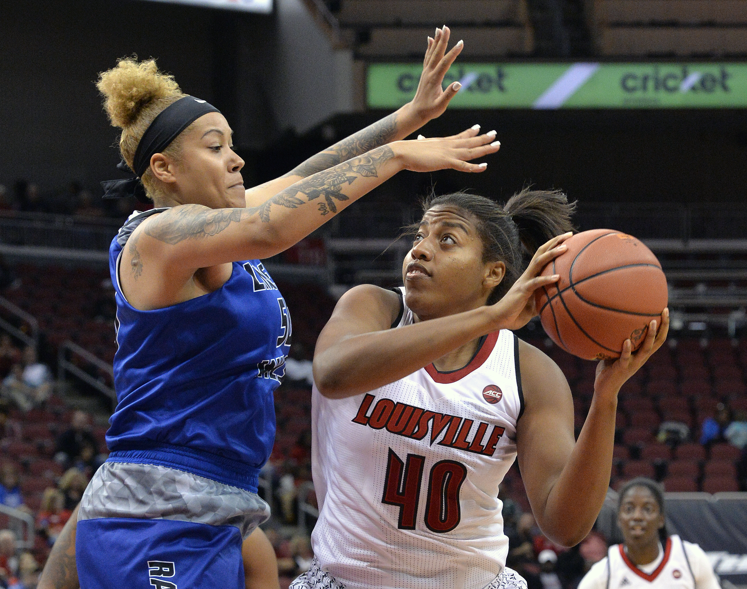 Louisville's Ciera Johnson (40) looks to shoot over the defense of Lindsey Wilson's Michelle Montgomery (50) during an NCAA college basketball exhibition game, Sunday, Nov. 6, 2016 in Louisville Ky. (AP Photo/Timothy D. Easley)