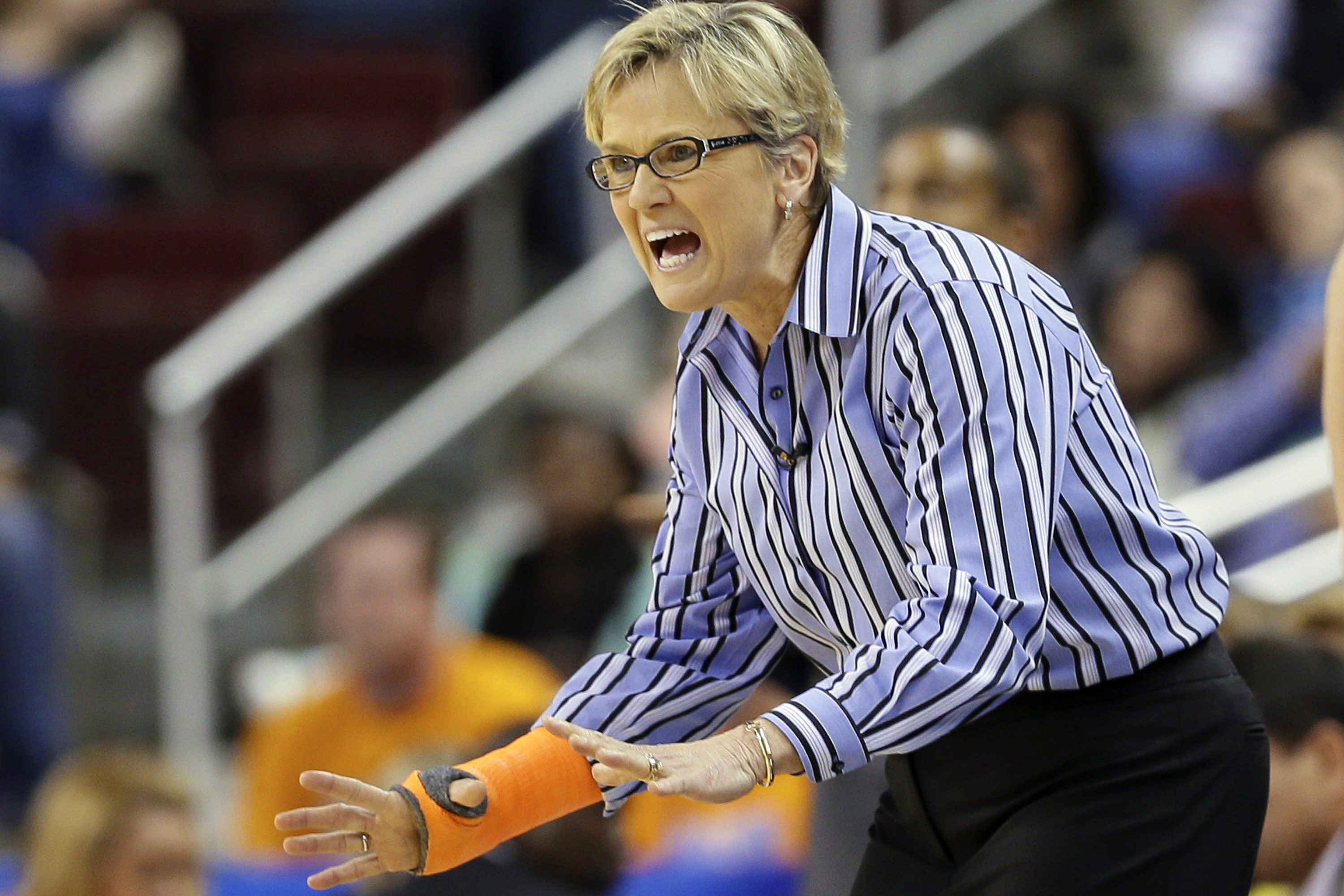 FILE - In this March 7, 2015, file photo, Tennessee coach Holly Warlick shouts in the second half of a Southeastern Conference tournament semifinal NCAA college basketball game against Kentucky,  in North Little Rock, Ark. Warlick has endured a difficult