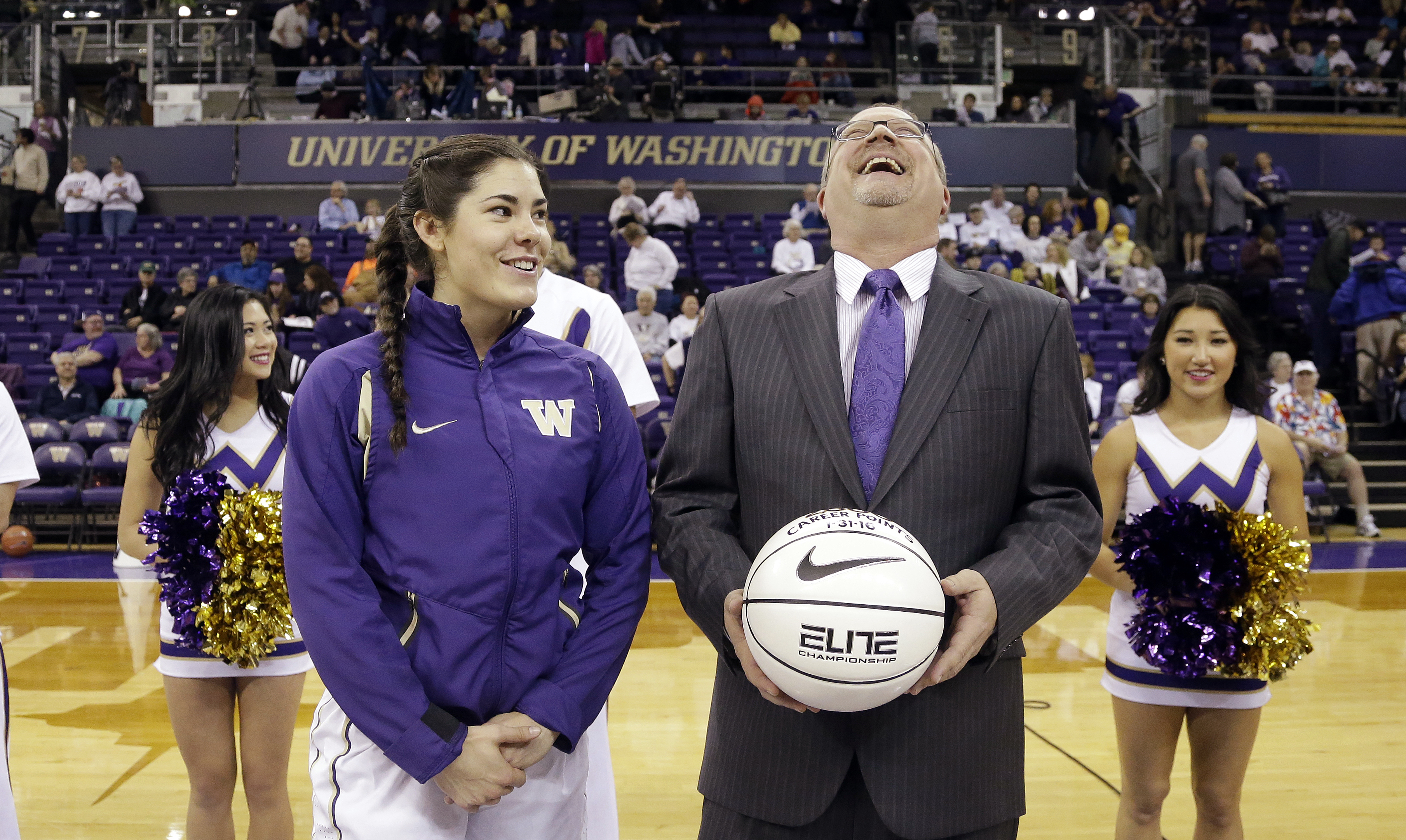 FILE - In this Feb. 5, 2016, file photo, Washington head coach Mike Neighbors, right, throws his head back and laughs in response to a comment from Kelsey Plum as Neighbors is about to hand Plum a basketball commemorating her 2,000 career points, in Seatt