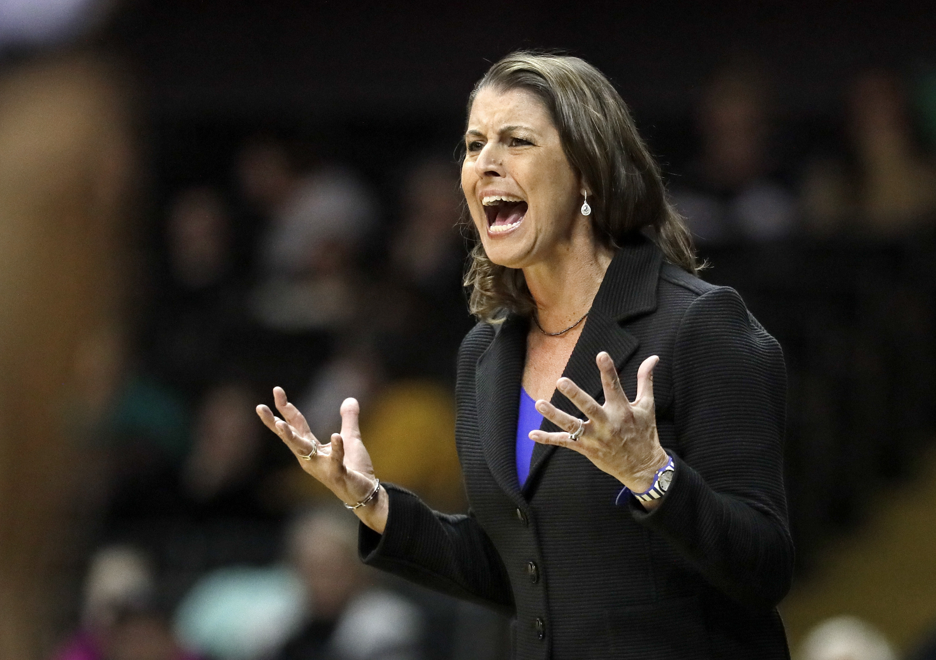 Duke head coach Joanne McCallie yells to her players in the first half of an NCAA college basketball game against Vanderbilt, Sunday, Nov. 20, 2016, in Nashville, Tenn. (AP Photo/Mark Humphrey)