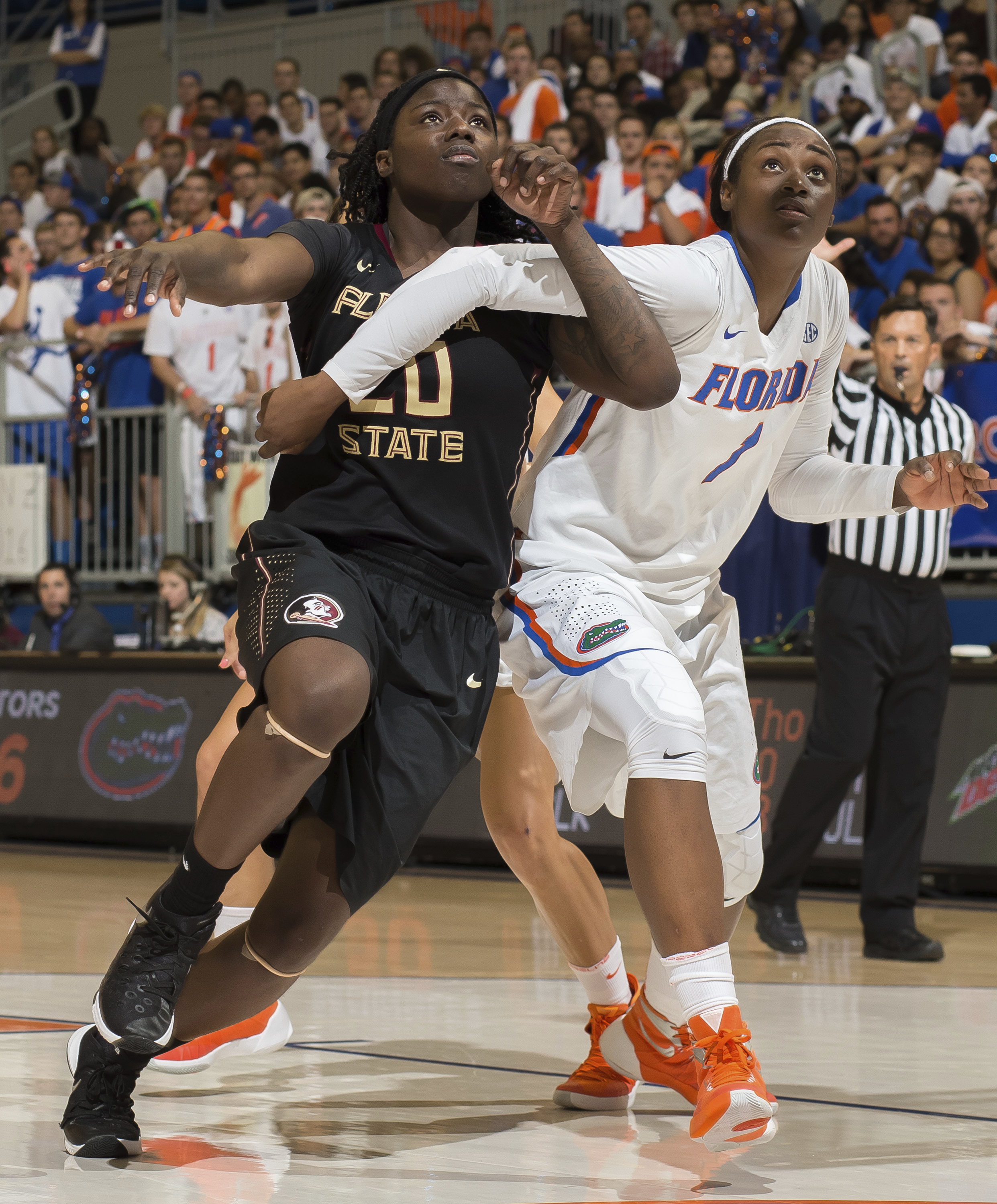 FILE- In tis Nov. 16, 2016 file photo, Florida State forward Shakayla Thomas (20) and Florida guard/forward Ronni Williams (1) battle for position under the basket during the second half of an NCAA college basketball game in Gainesville, Fla. For the firs