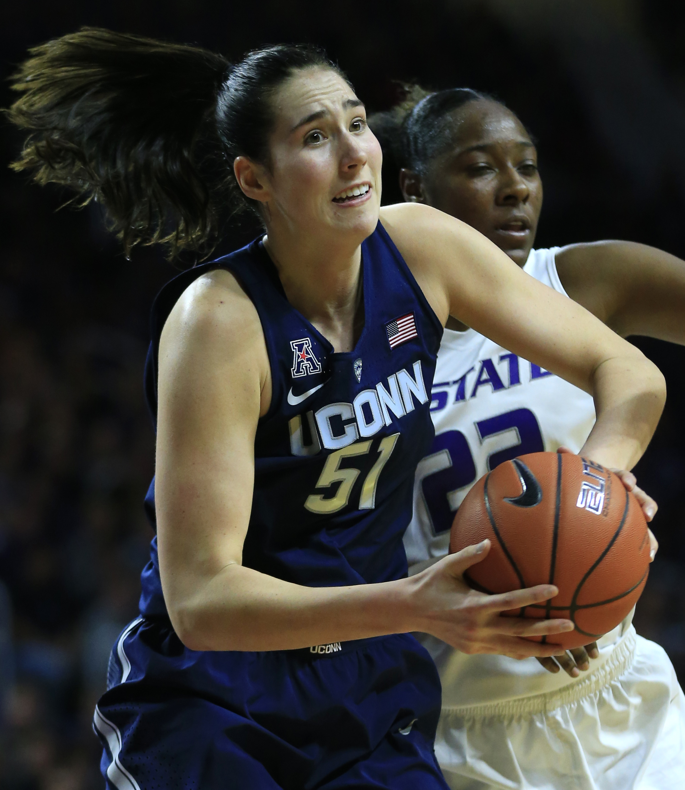 Connecticut center Natalie Butler (51) rebounds in front of Kansas State forward Breanna Lewis (22) during the first half of an NCAA college basketball game in Manhattan, Kan., Sunday, Dec. 11, 2016. (AP Photo/Orlin Wagner)