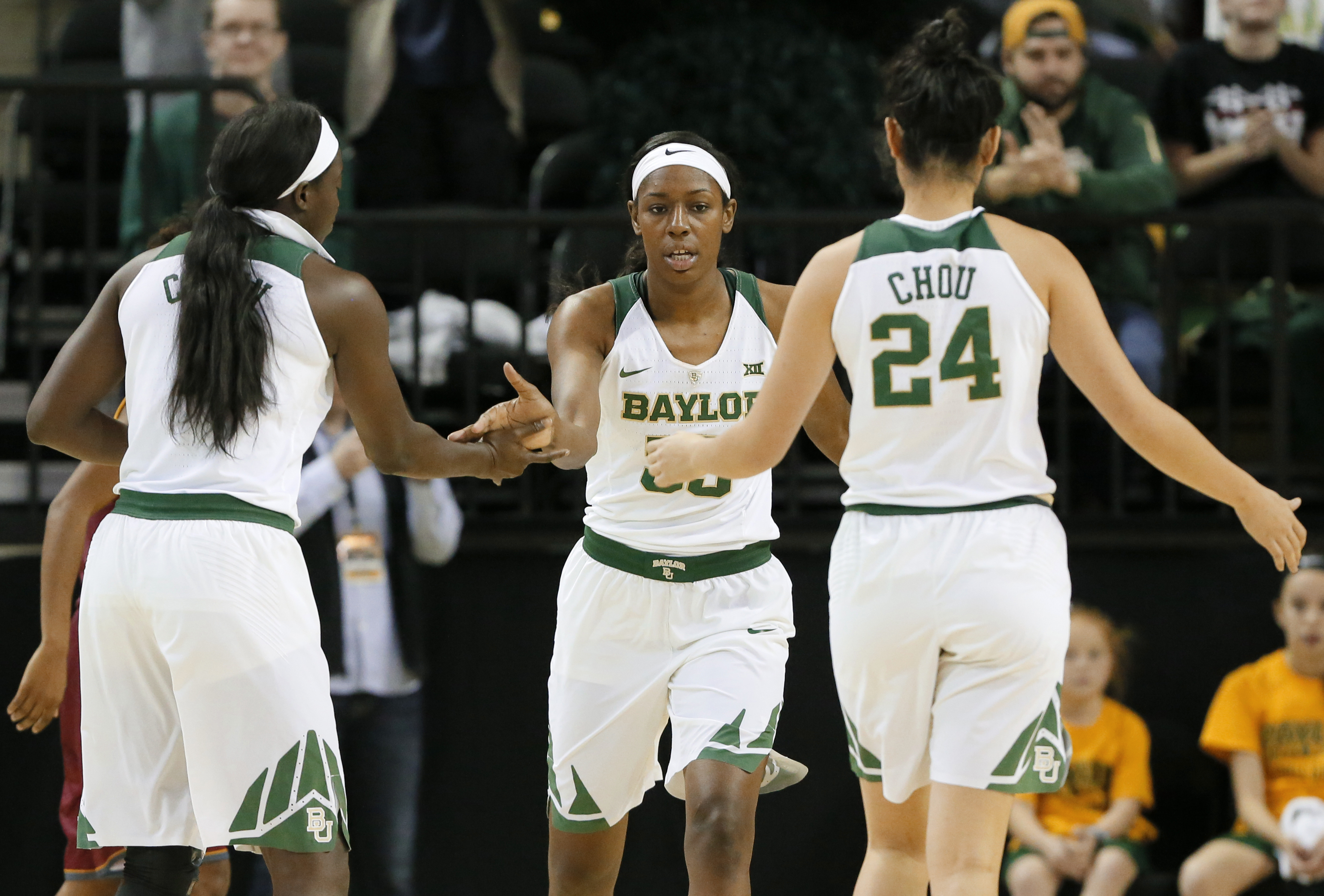 Baylor's Dekeiya Cohen, left, and Natalie Chou (24) celebrate a basket scored by Khadijiah Cave, center, in the first half of an NCAA college basketball game against Winthrop on Thursday, Dec. 15, 2016, in Waco, Texas. Cave led all scoring with 25 points