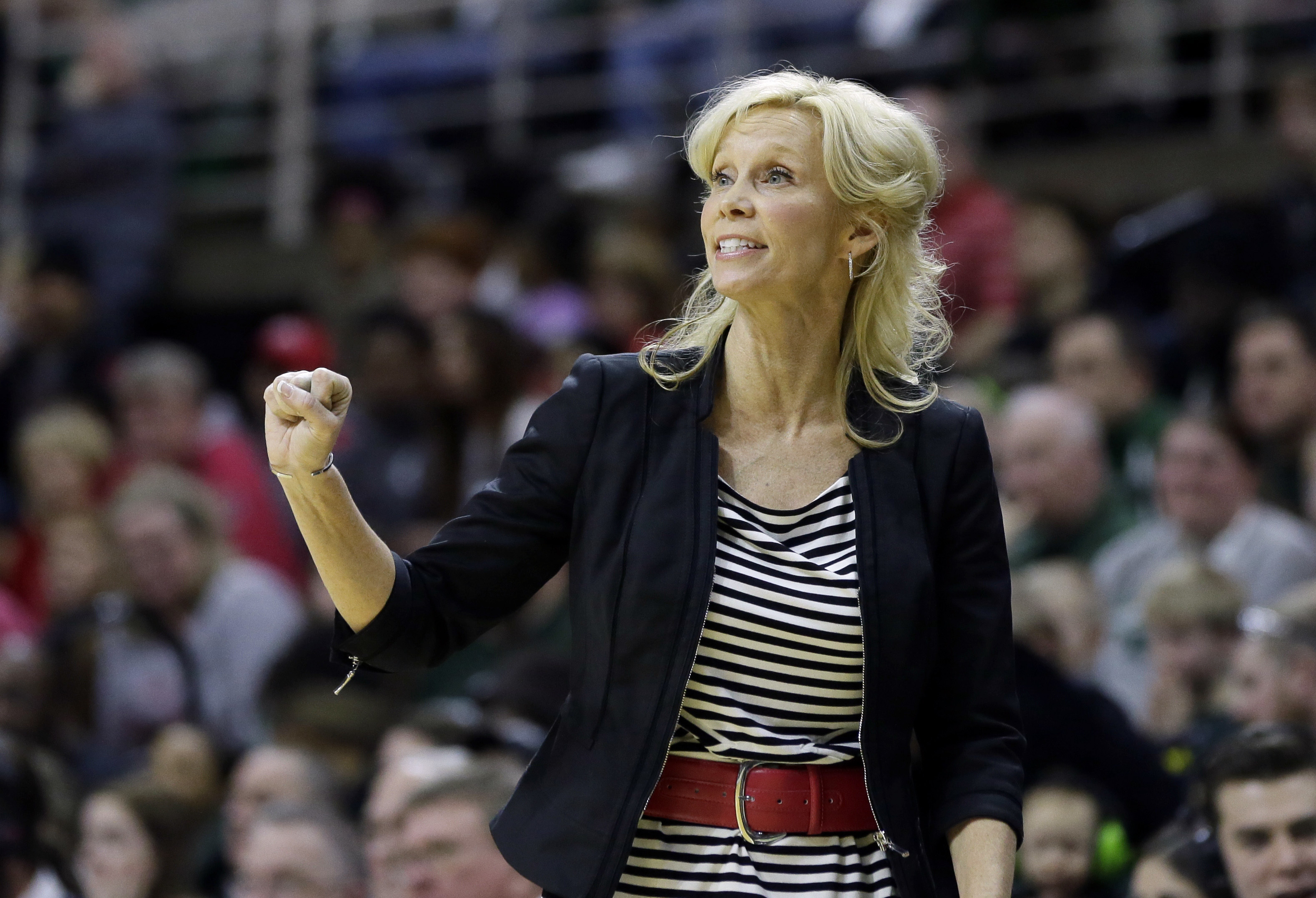 FILE- In this Feb. 27, 2016, file photo, Michigan State head coach Suzy Merchant gestures as she watches from the sidelines during the second half of an NCAA college basketball game against Ohio State in East Lansing, Mich. Merchant fainted while coaching
