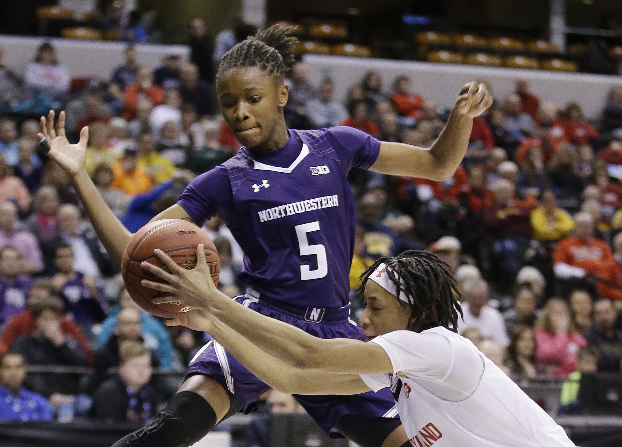 FILE - In this March 5, 2016, file photo, Maryland's Brene Moseley (3) and Northwestern's Jordan Hankins (5) go for a loose ball during an NCAA college basketball game at the Big Ten Conference tournament in Indianapolis. Hankins has been found dead in he