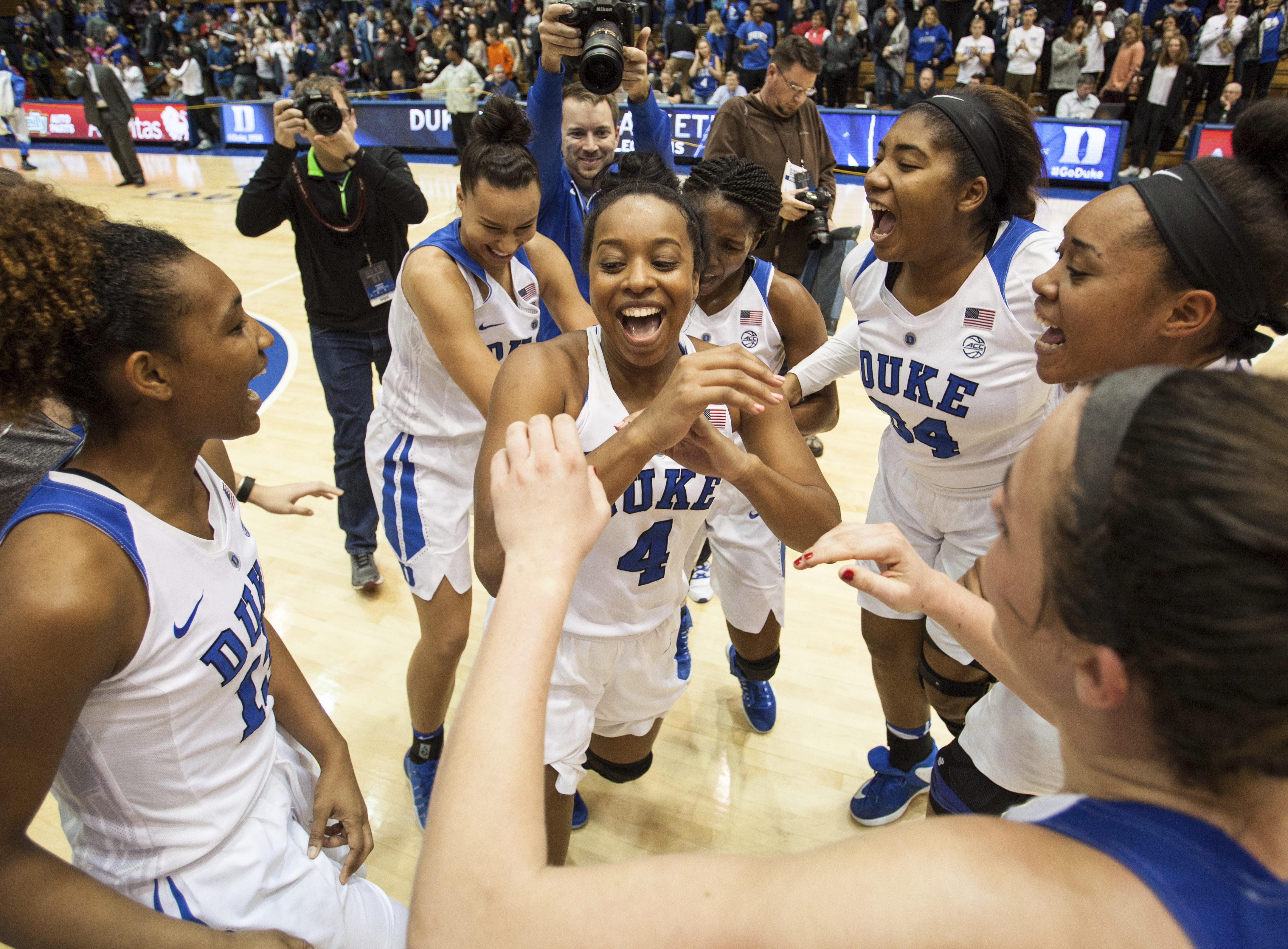 FILE - In this Dec. 4, 2016, file photo, Duke's Lexie Brown (4) celebrates with her teammates following a victory in an NCAA college basketball game against South Carolina, in Durham, N.C. Lexie Browns father is best known for his creative dunks. The daug