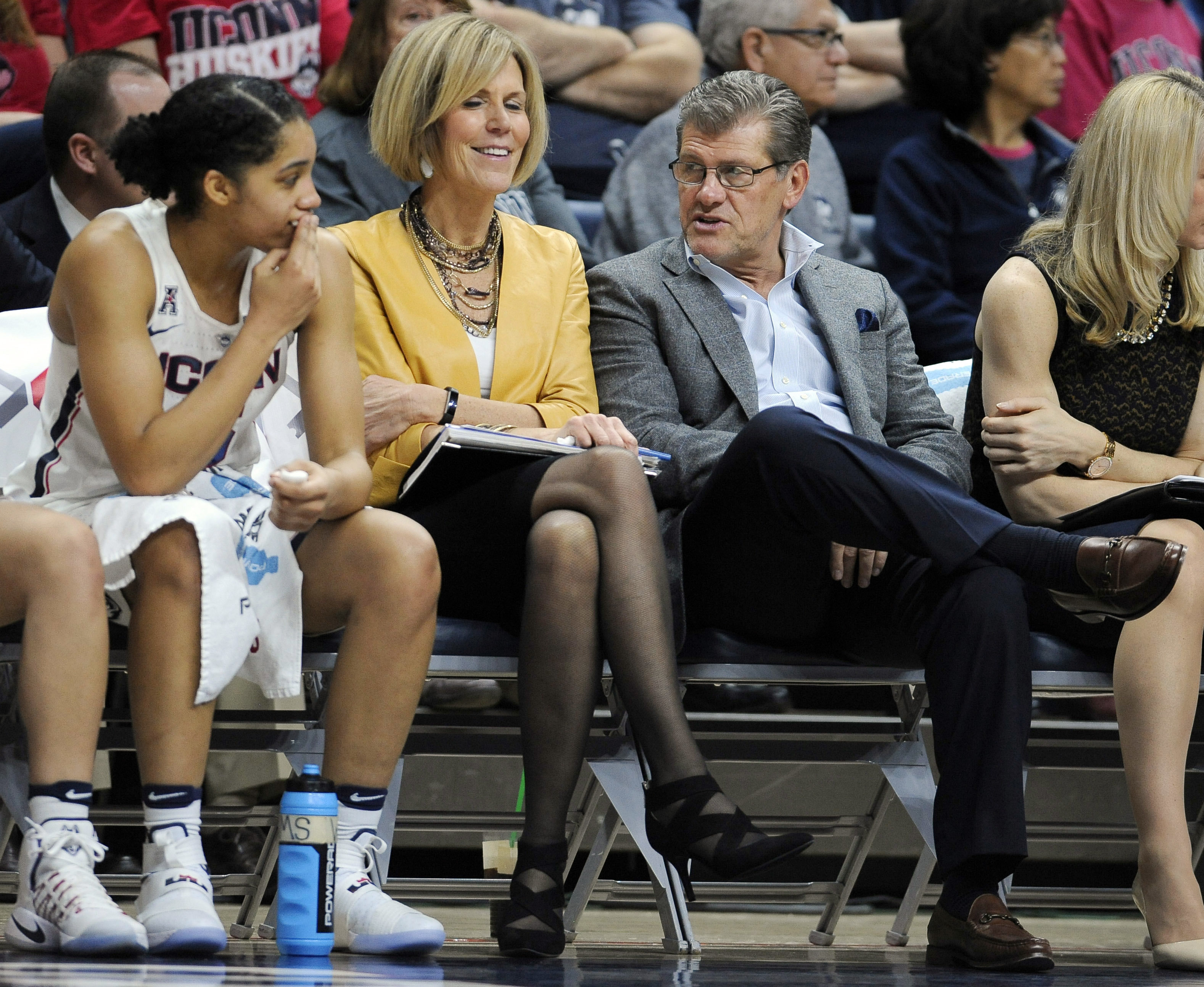 Connecticut head coach Geno Auriemma, third from left, talks with player Gabby Williams, left, as associate head coach Chris Daily, center, listens in the second half of an NCAA college basketball game against Tulane, Sunday, Jan. 22, 2017, in Storrs, Con