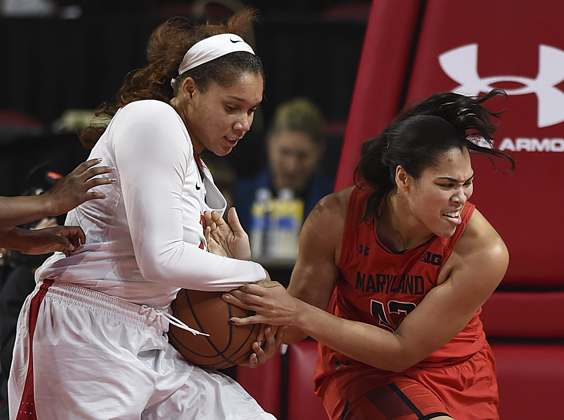 Maryland's Brionna Jones, right, and Rutgers Jordan Wallace fight for a rebound during the first half of an NCAA college basketball game, Sunday, Jan. 22, 2017, in College Park, Md. (AP Photo/Gail Burton)