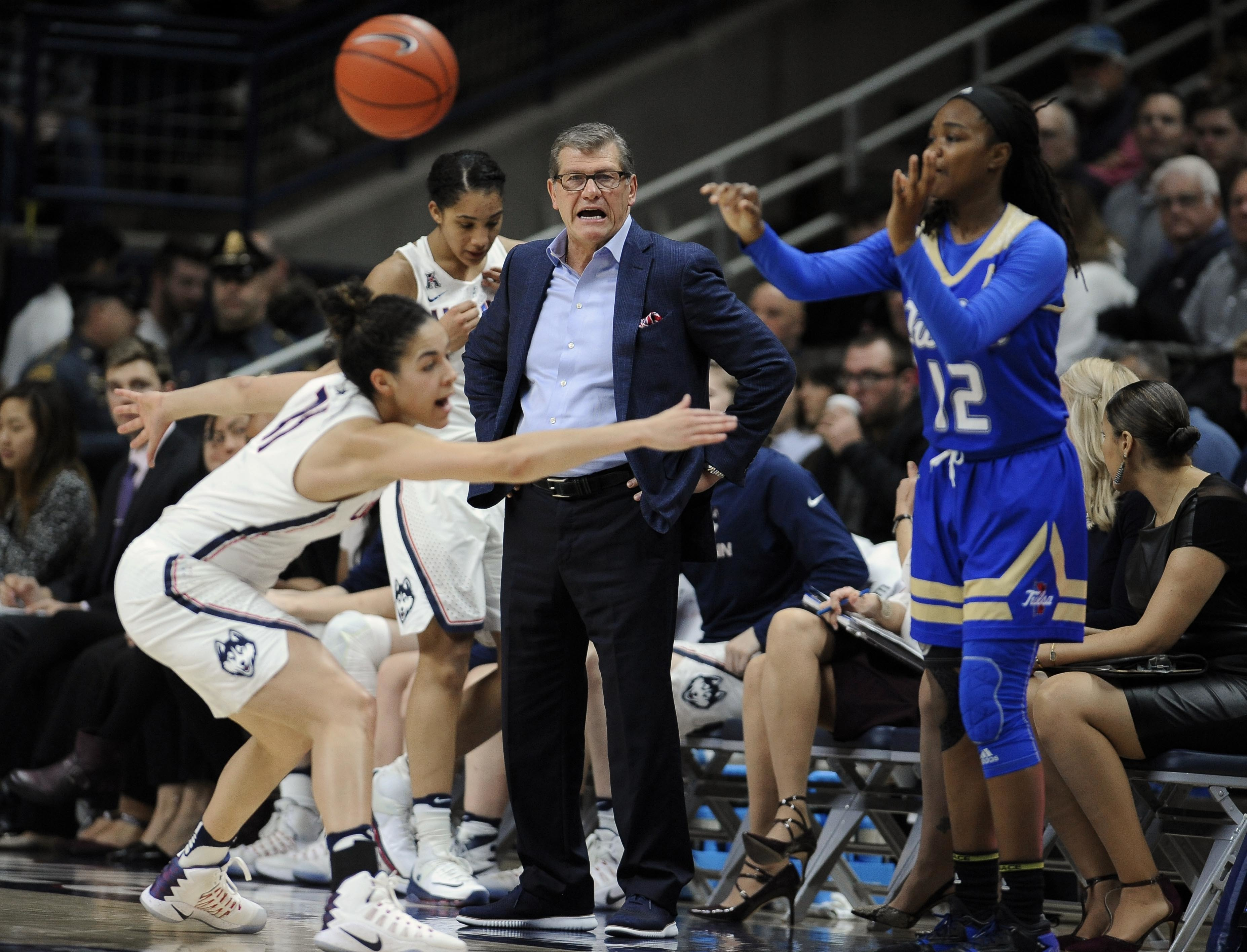 Connecticut head coach Geno Auriemma, center, calls to Connecticut's Kia Nurse, left, as Tulsa's Shug Dickson inbounds the ball in the half of an NCAA college basketball game, Sunday, Feb. 5, 2017, in Storrs, Conn. (AP Photo/Jessica Hill)