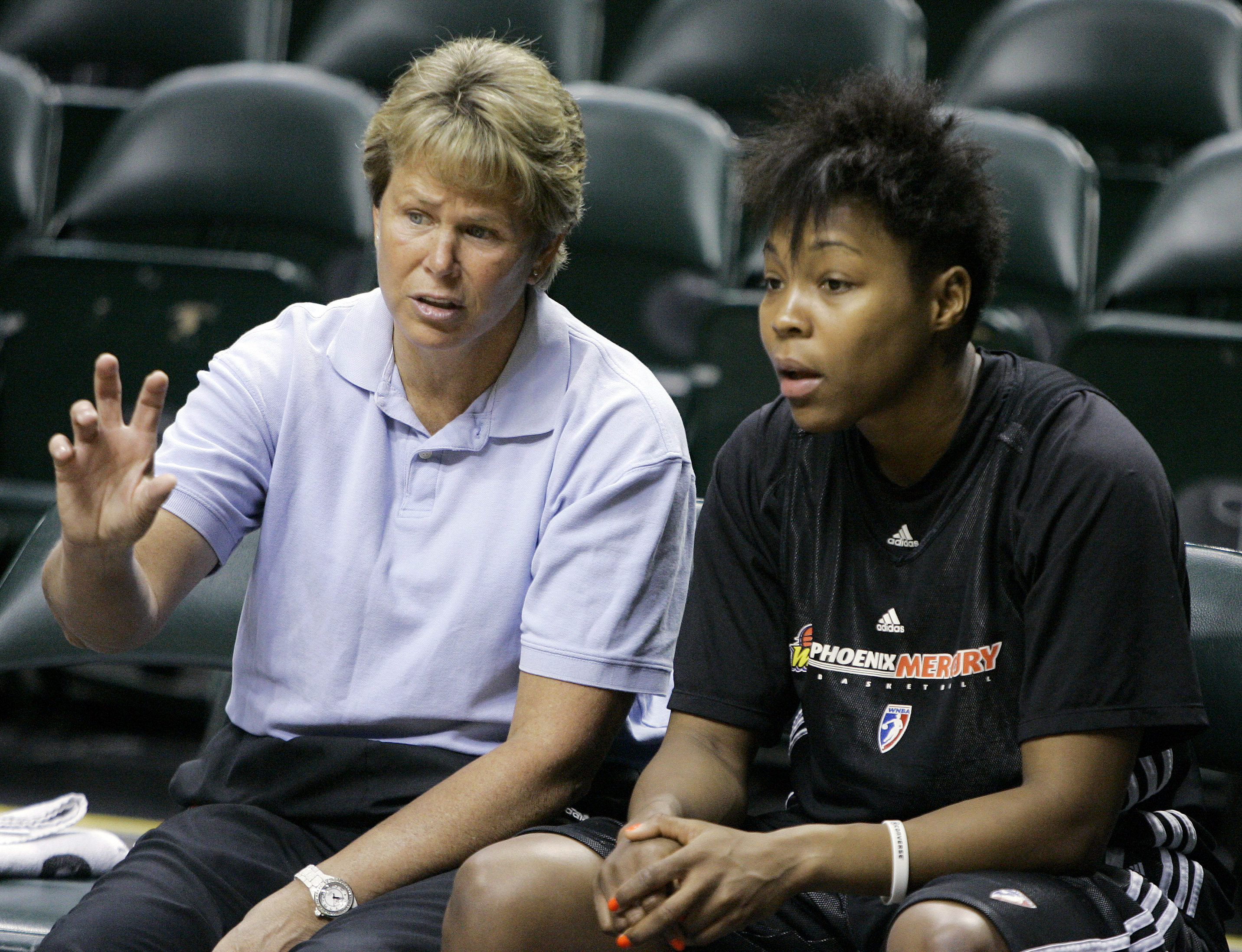Phoenix Mercury general manager Ann Meyers Drysdale, left, talks with  forward Cappie Pondexter as they wait for the start of practice for the WNBA Finals in Indianapolis, Tuesday, Oct. 6, 2009. The Indiana Fever lead the series 2-1. Game 4 is scheduled f