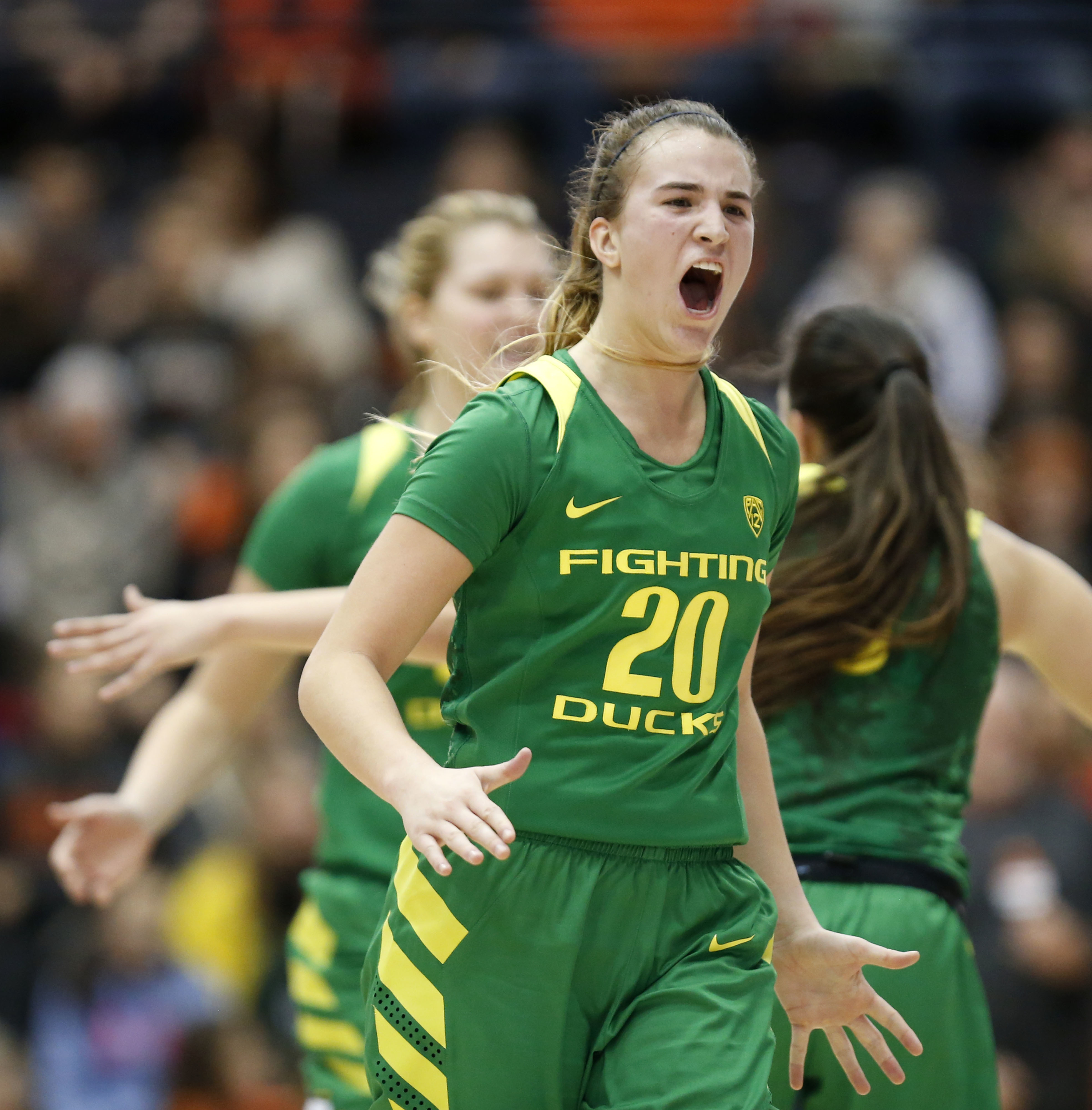 In this Jan. 29, 2017 photo, Oregon's Sabrina Ionescu yells as she comes to the bench during an NCAA college basketball game against Oregon State in Corvallis, Ore. With four triple-doubles this season, Oregon's 5-foot-10 guard is a driving force behind t