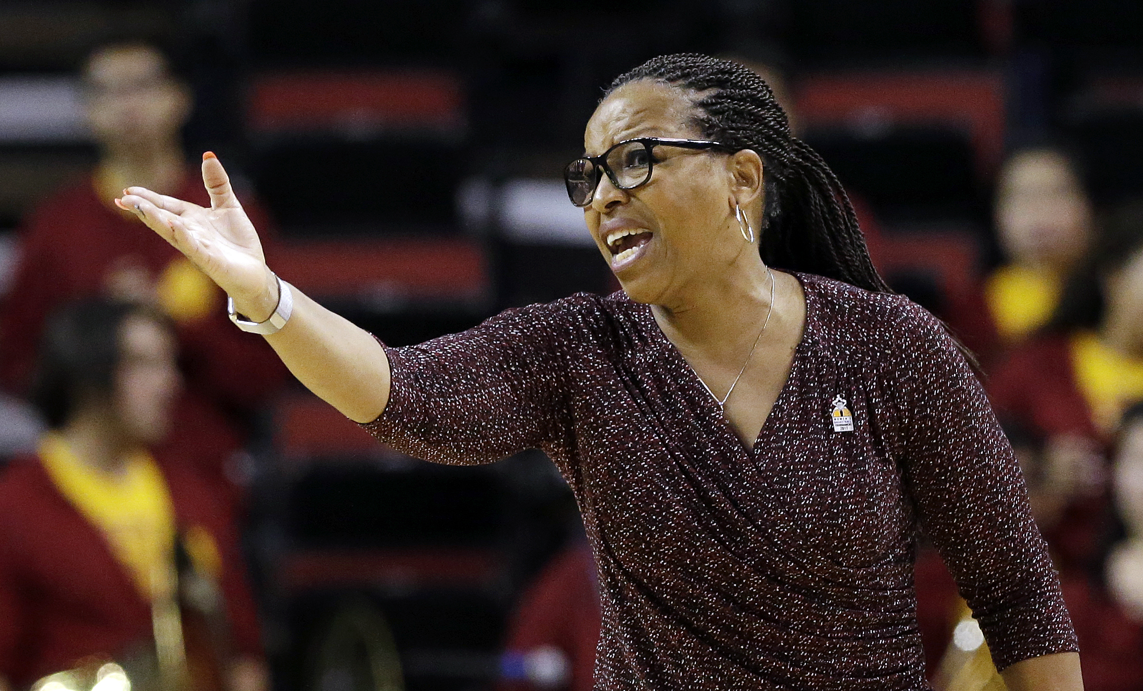 FILE - In this Thursday, March 2, 2017, file photo, Southern California head coach Cynthia Cooper-Dyke directs her team against California in an NCAA college basketball game in the Pac-12 Conference tournament  in Seattle. Cooper-Dyke resigned on Friday,