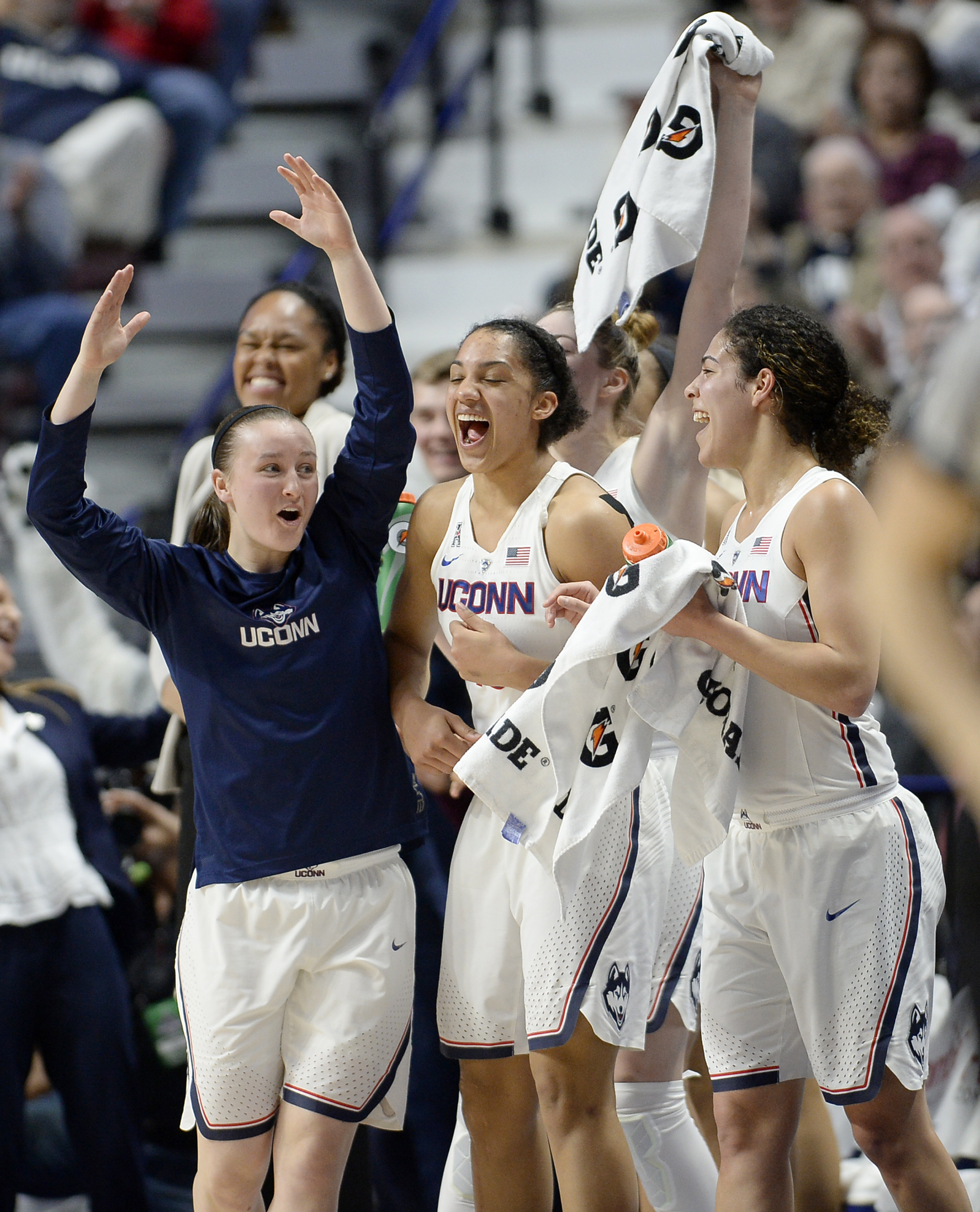 Connecticut's Tierney Lawlor, left, celebrates with Gabby Williams, center, and Kia Nurse, right, during the second half of an NCAA college basketball game against South Florida in the American Athletic Conference tournament finals at Mohegan Sun Arena, M