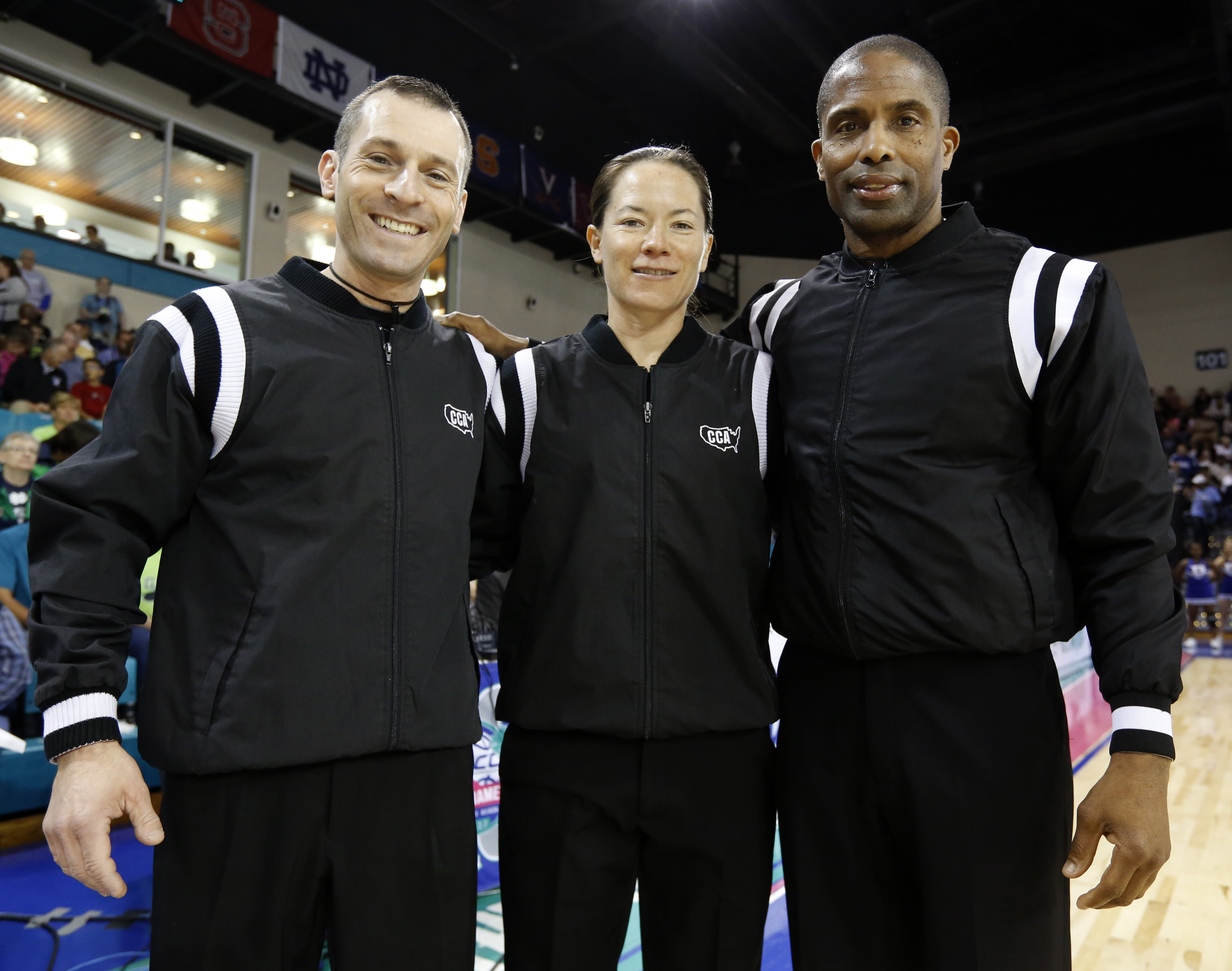 In this Sunday, March 5, 2017, photo, officials Joe Vaszily, from left, Maj Forsberg and Eric Brewton pose before the start of the women's basketball game between Duke and Notre Dame at the NCAA college championship basketball game in the Atlantic Coast C