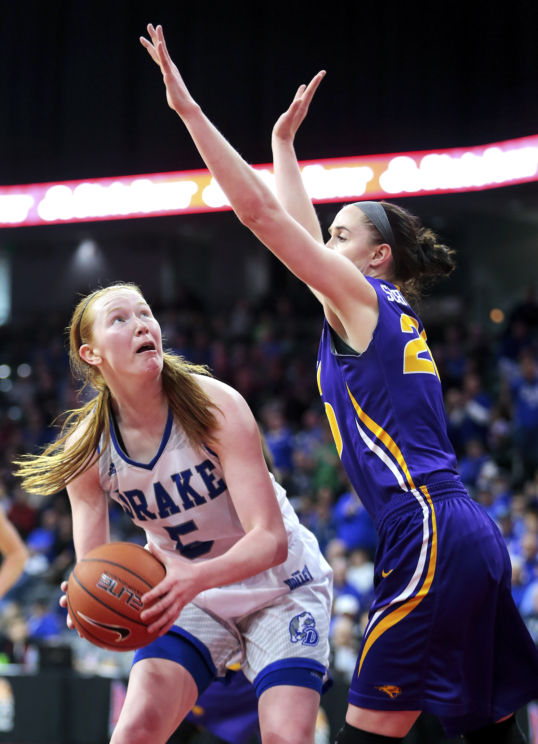 Drake's Becca Hittner, left, tries to get around Northern Iowa's Hannah Schonhardt during an NCAA college basketball game for the Missouri Valley Conference tournament title Sunday, March 12, 2017, in Moline, Ill. Drake defeated Northern Iowa in overtime,
