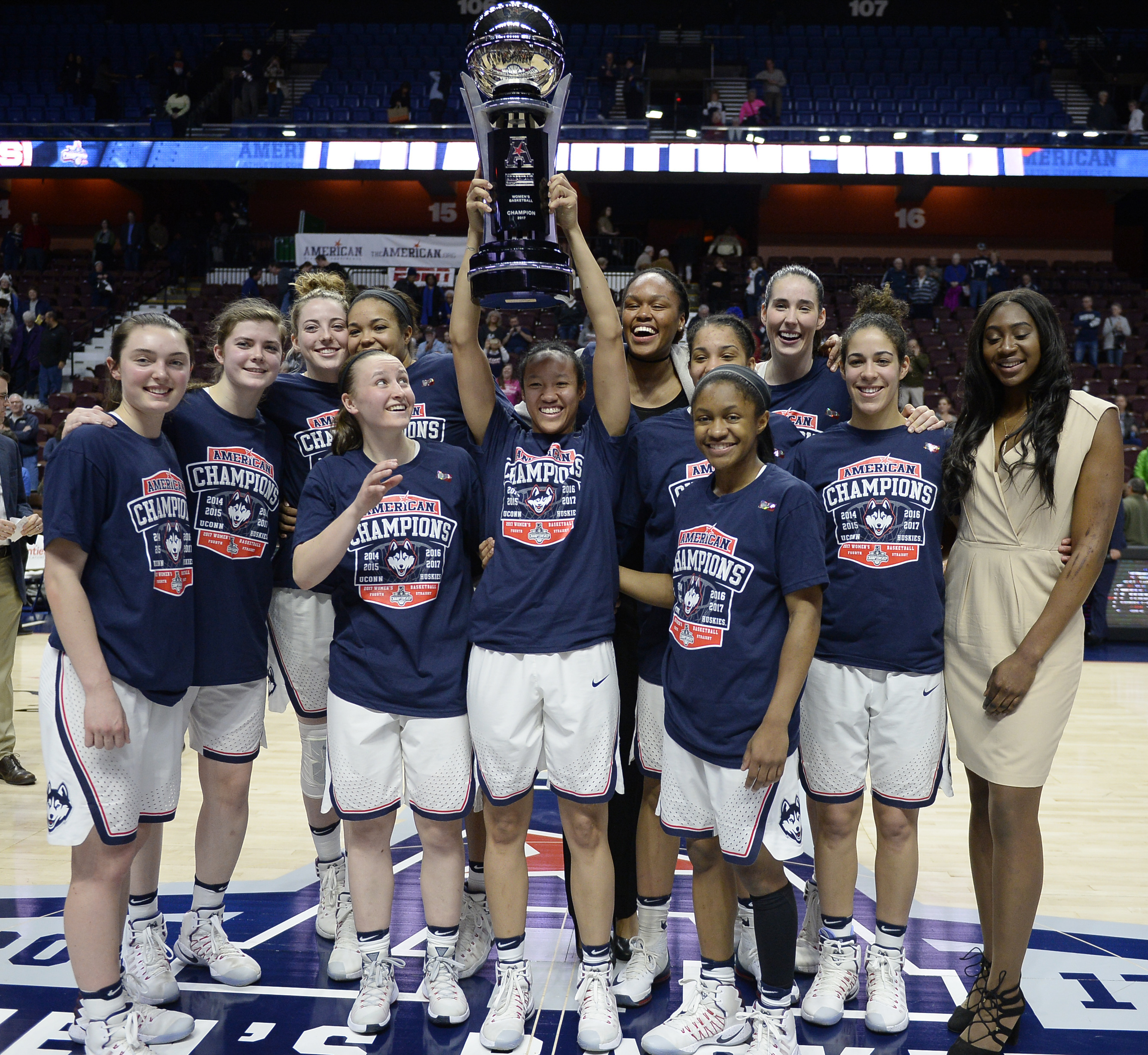 FILE - In this March 6, 2017, file photo, the Connecticut women's basketball team pose with the American Athletic Conference championship trophy after defeating South Florida in an NCAA college basketball game tournament final in Uncasville, Conn.  UConn