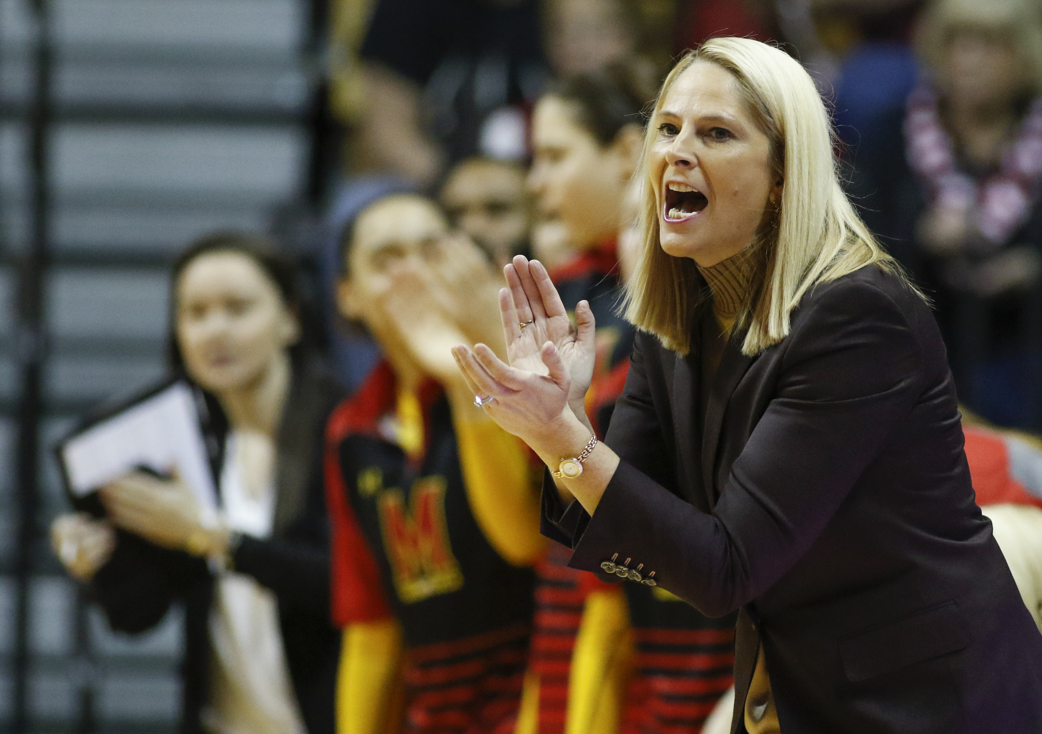 FILE - In this Sunday, Feb. 5, 2017, file photo ,Maryland head coach Brenda Frese cheers on her team during the first half of an NCAA college basketball game against Indiana in Bloomington, Ind. Ranked fourth in the country after going 30-2 and being crow