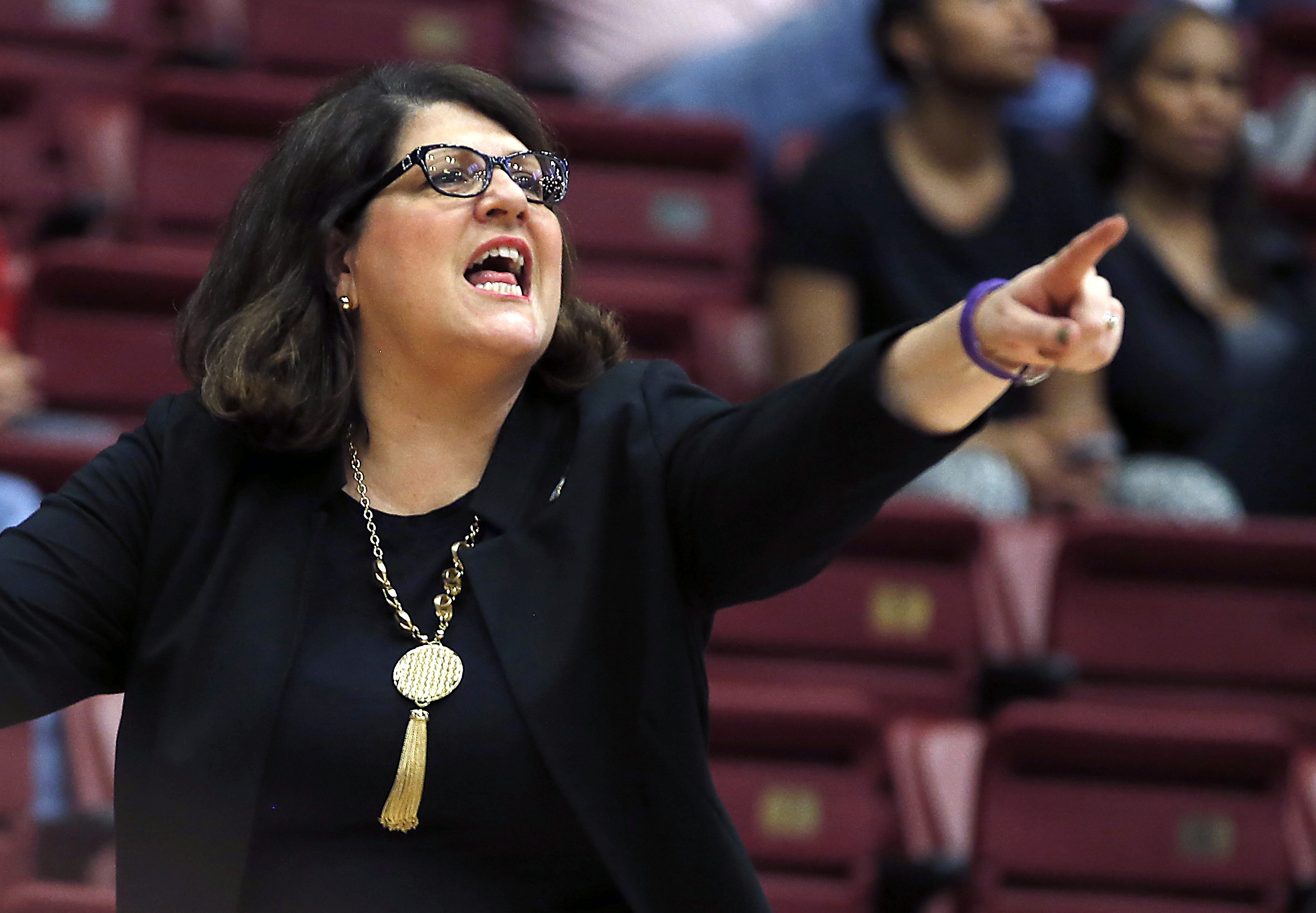 FILE - In this March 21, 2015, file photo, Quinnipiac head coach Tricia Fabbri directs her players during the first half in a first round game at the NCAA college basketball tournament in Stanford, Calif. With little chance to host in womens NCAA Tourname