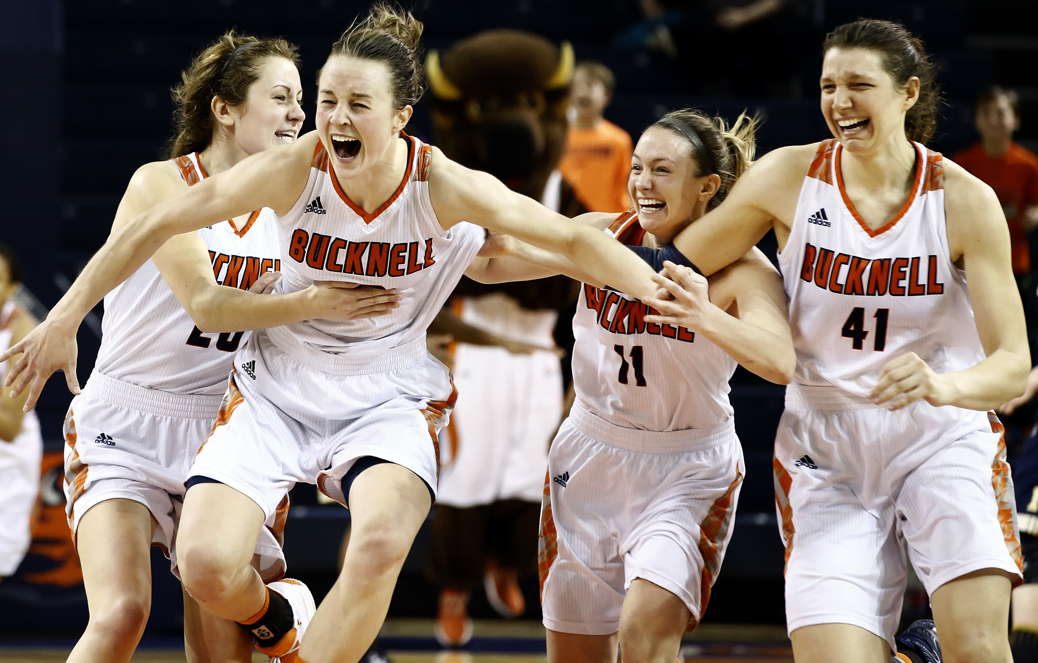 FILE - In this Sunday, March 12, 2017, file photo, Bucknell's Kate Walker (20), Claire DeBoer (12), Megan McGurk (11) and Sune Stewart (41) celebrate after defeating Navy in overtime of an NCAA college basketball Patriot League Championship game in Lewisb