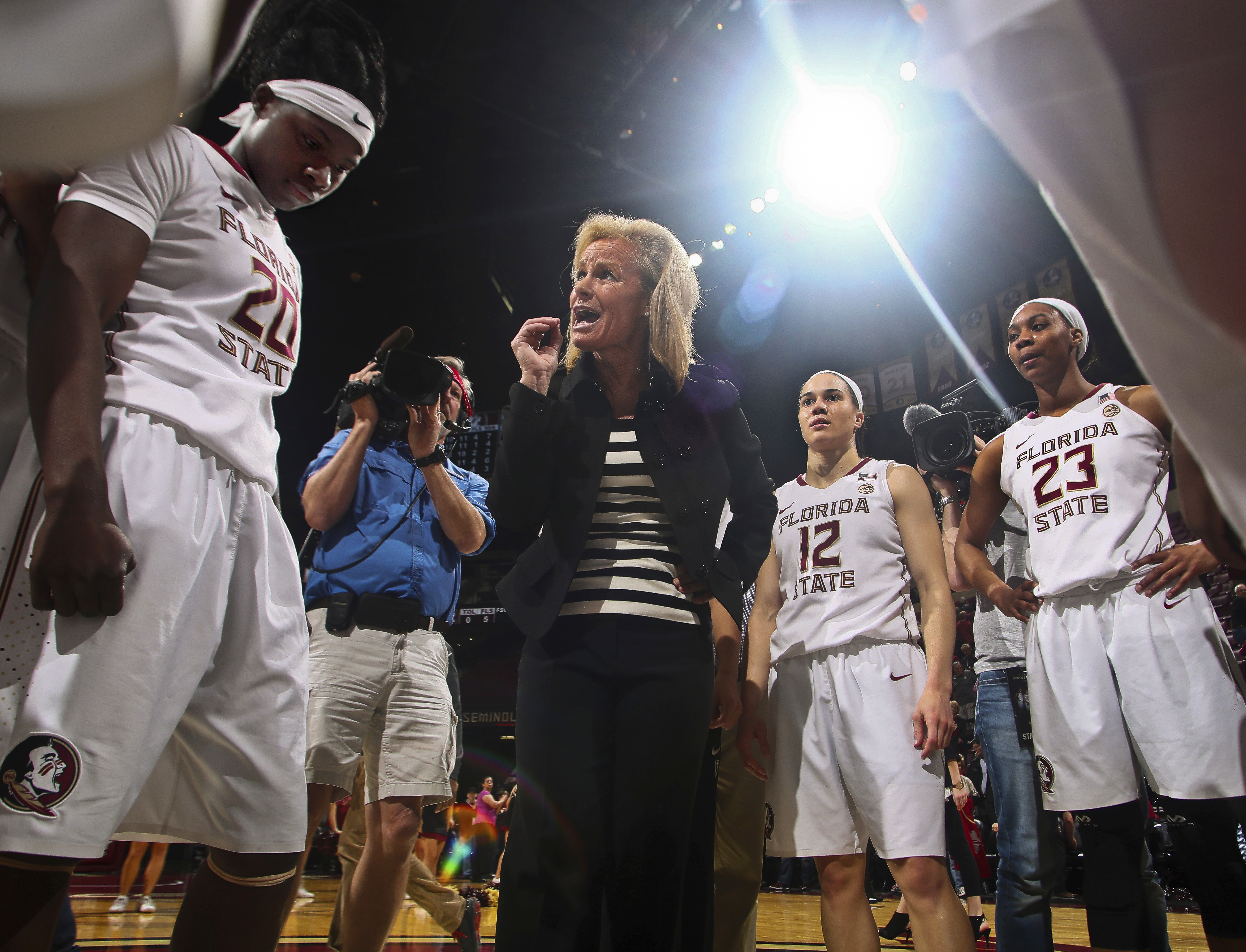 FILE - In this Feb. 6, 2017, file photo, Florida State coach Sue Semrau talks to her players, including forward Shakayla Thomas (20), guard Brittany Brown (12) and Ivey Slaughter (23) after an NCAA college basketball game against Miami in Tallahassee, Fla