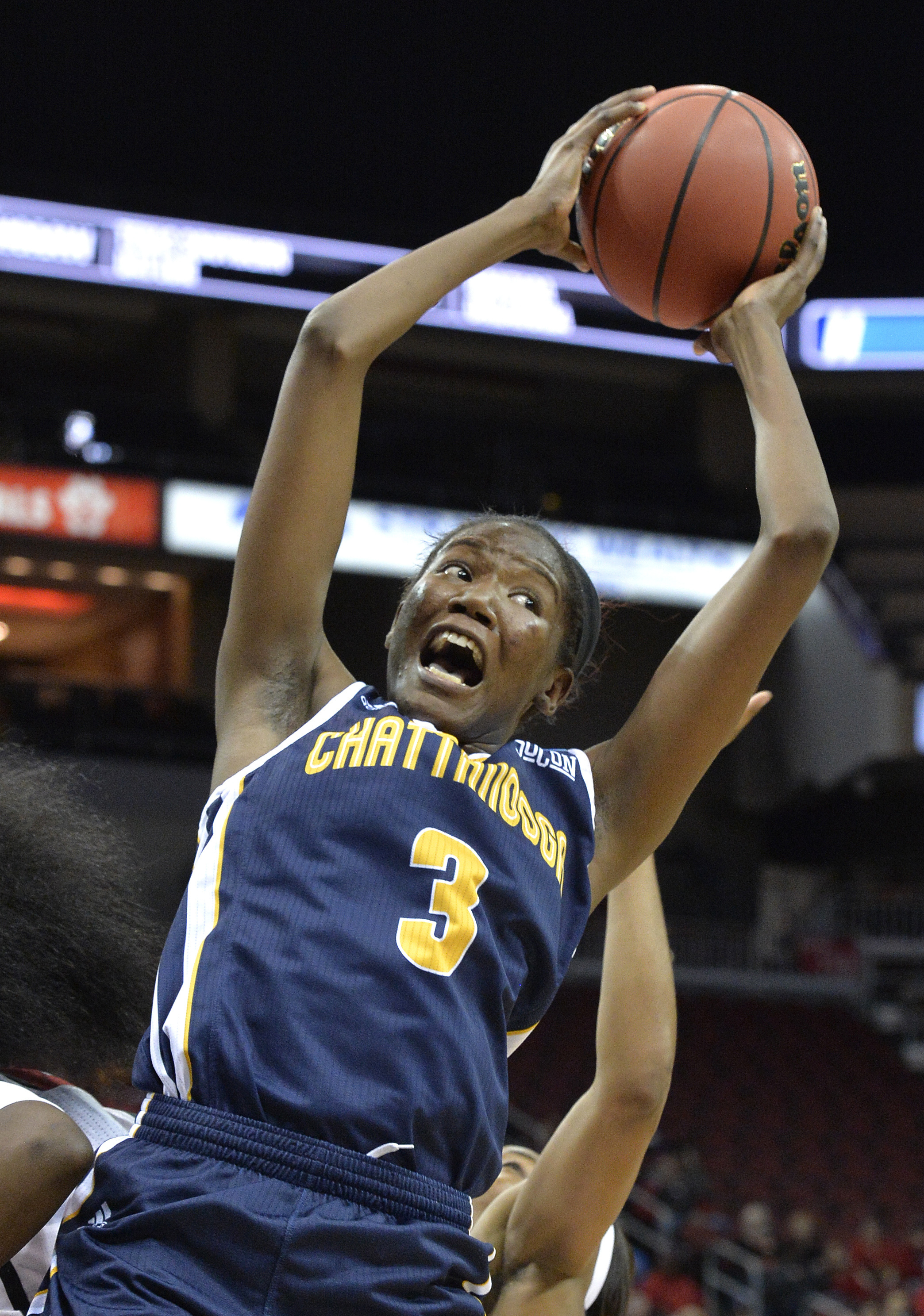 Chattanooga's Jasmine Joyner (3) pulls down a rebound in the first half of a first-round game in the women's NCAA college basketball tournament against Louisville, Saturday, Mar. 18, 2017, in Louisville, Ky. (AP Photo/Timothy D. Easley)
