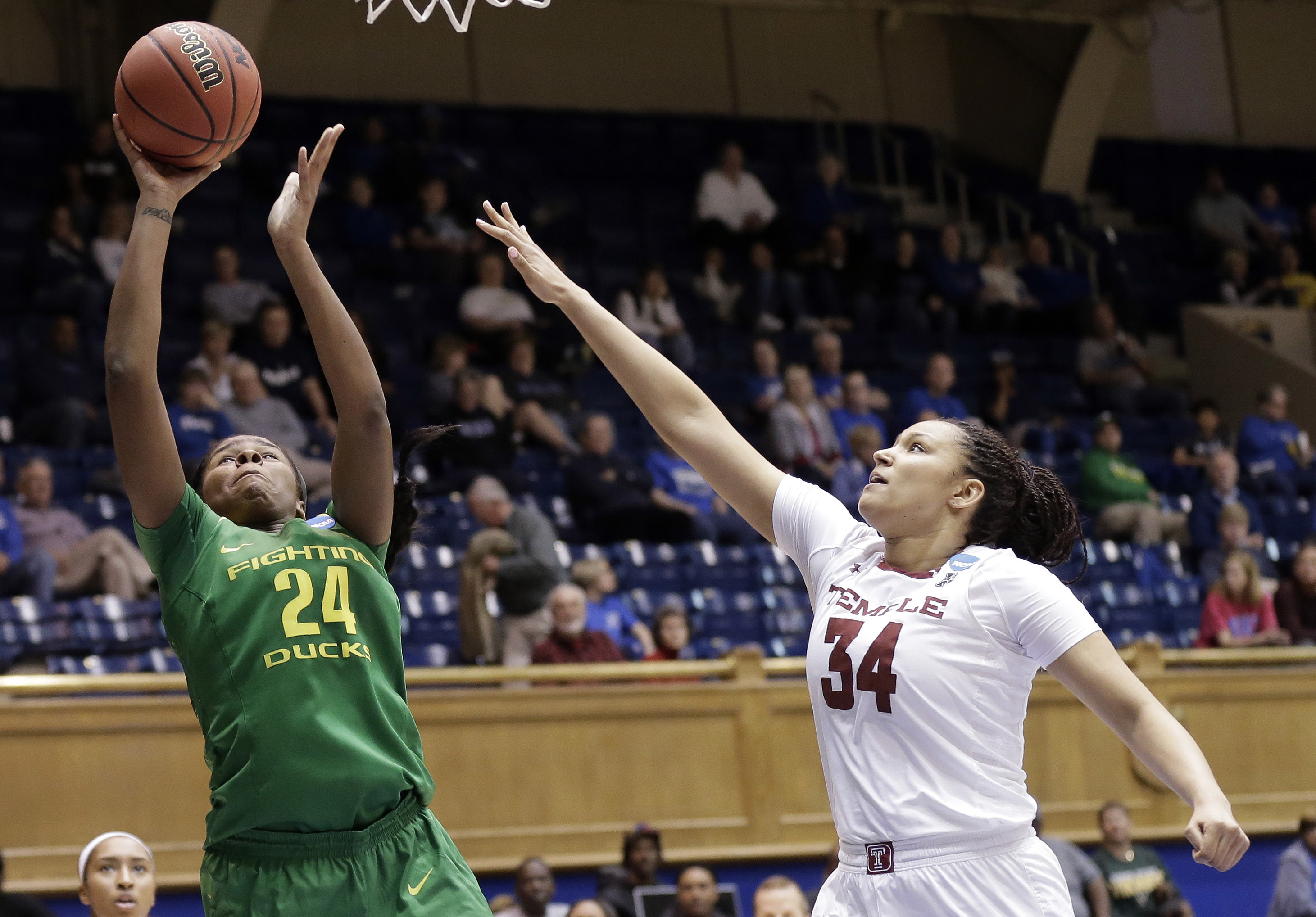 Oregon's Ruthy Hebard (24) shoots while Temple's Monasia Bolduc (34) defends during the first half of a first-round game in the NCAA women's college basketball tournament in Durham, N.C., Saturday, March 18, 2017.  (AP Photo/Gerry Broome)