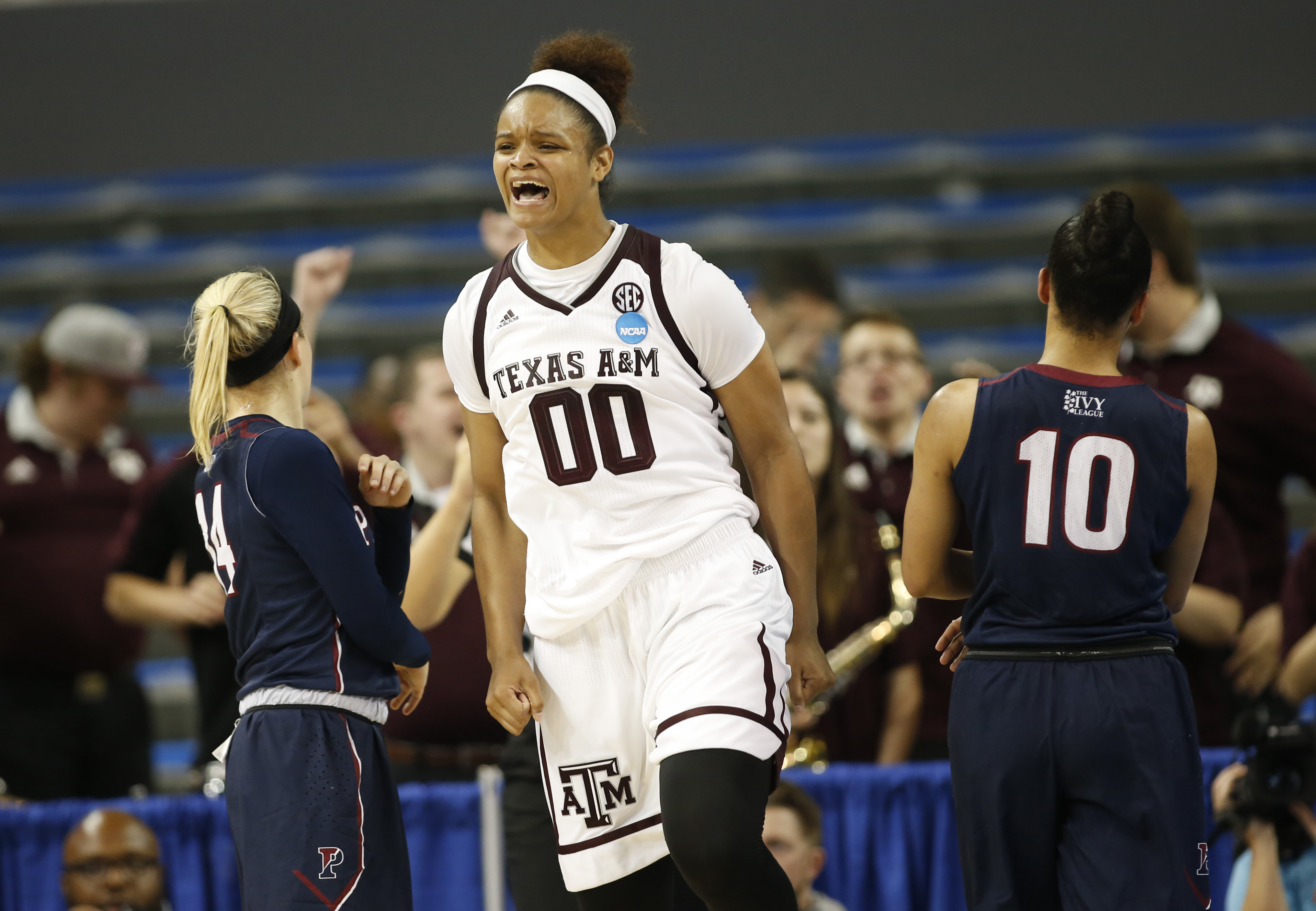 Texas A&M center Khaalia Hillsman celebrates after being fouled and still making her shot against Penn during the second half of a first-round game in the NCAA women's college basketball tournament, Saturday, March 18, 2017, in Los Angeles. (AP Photo/Dann