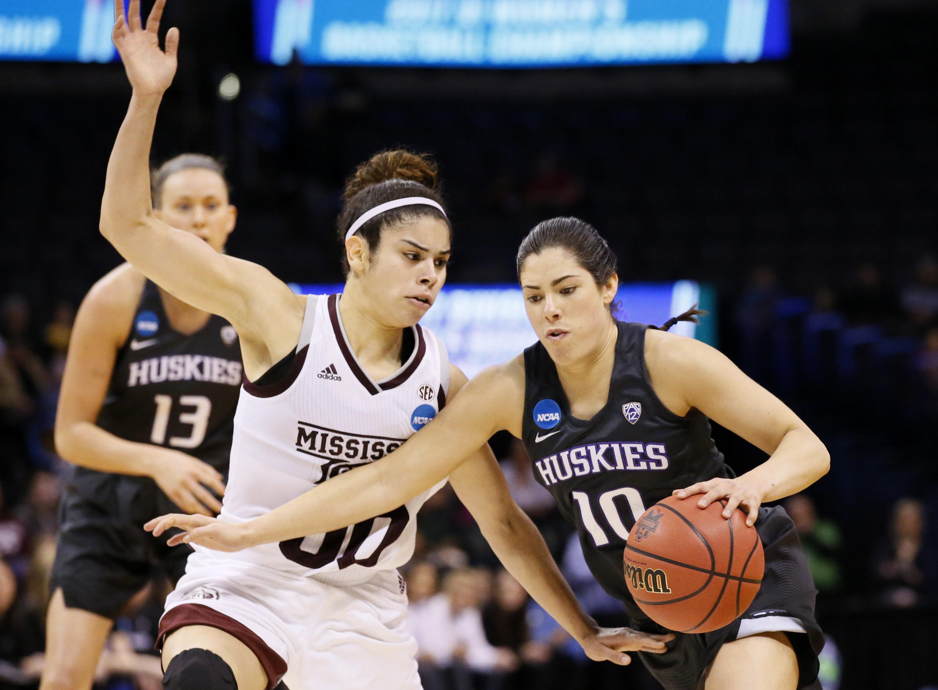 Washington guard Kelsey Plum drives past Mississippi State guard Dominique Dillingham, left, during the first half of a regional semifinal of the NCAA women's college basketball tournament, Friday, March 24, 2017, in Oklahoma City. (AP Photo/Sue Ogrocki)
