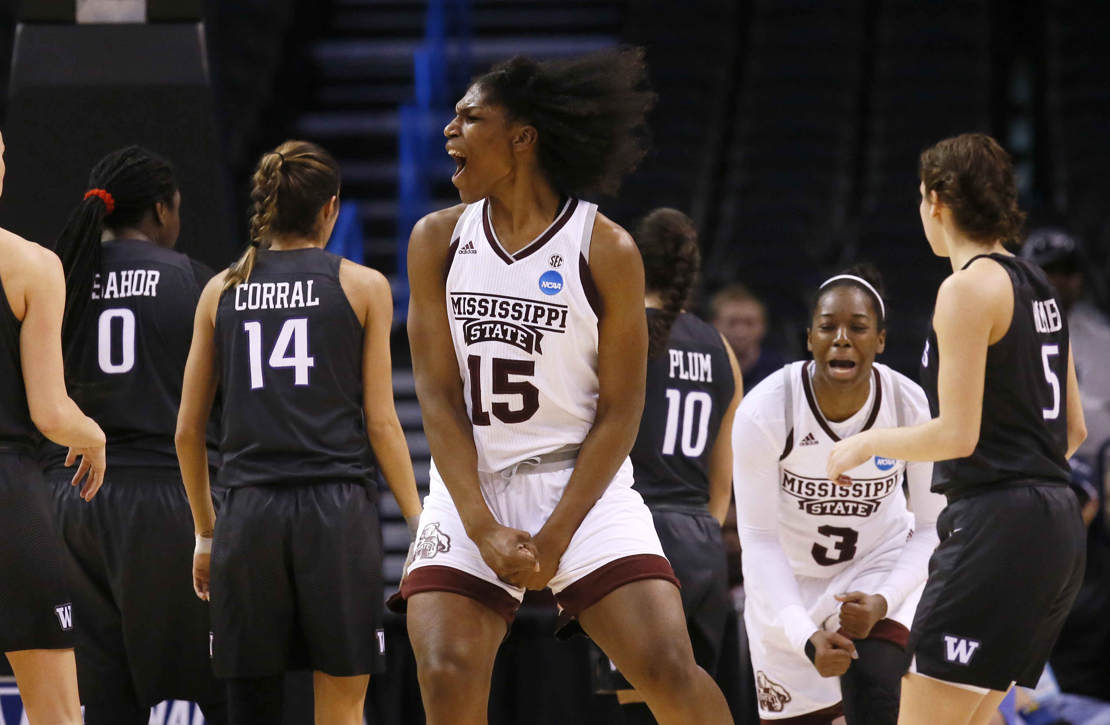 Mississippi State center Teaira McCowan (15) celebrates during the second half of a regional semifinal against Washington in the NCAA women's college basketball tournament, Friday, March 24, 2017, in Oklahoma City. (AP Photo/Sue Ogrocki)
