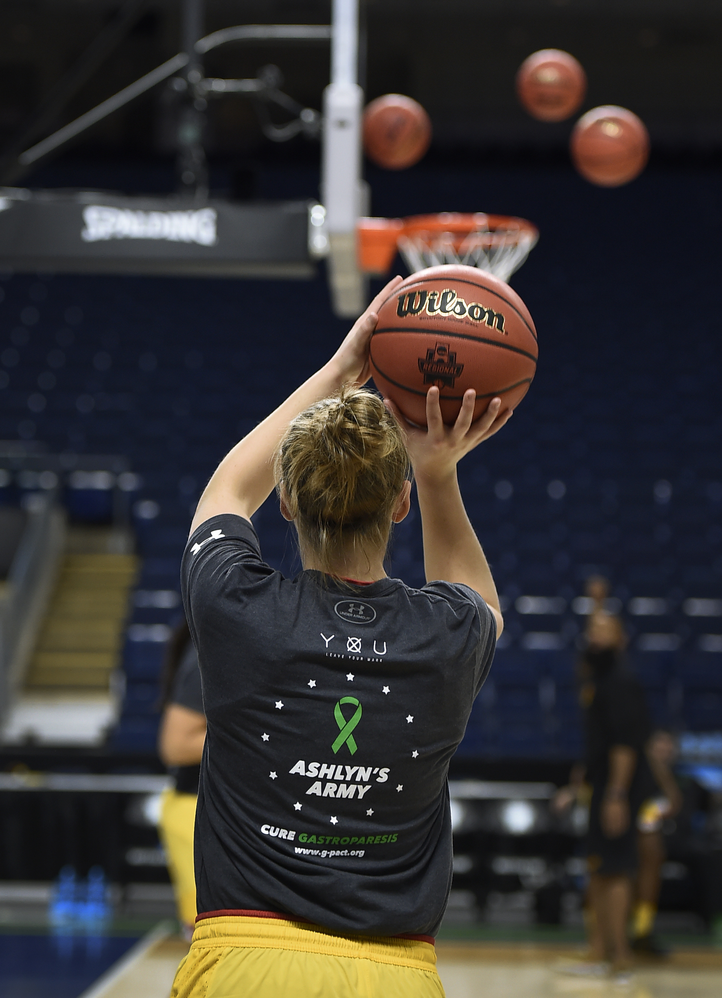 Maryland's Kristen Confroy wears a shirt for Ashlyn Barrett, who suffers from muscular dystrophy in the pregame warm-ups before a regional semifinal game against Oregon in the NCAA women's college basketball tournament, Saturday, March 25, 2017, in Bridge