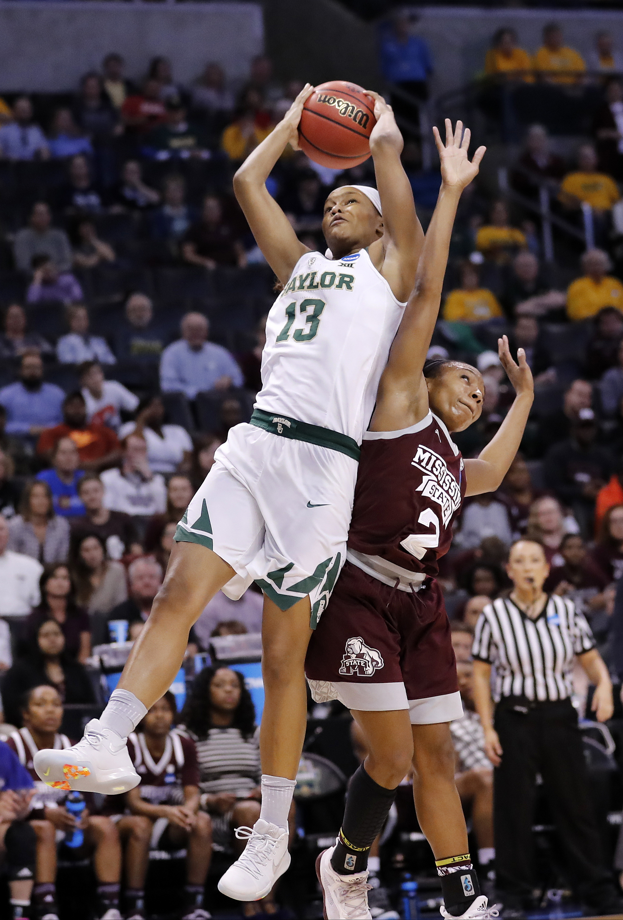 Baylor's Nina Davis (13) grabs a rebound against Mississippi State's Morgan William (2) during the first half of a regional final of the NCAA women's college basketball tournament, Sunday, March 26, 2017, in Oklahoma City. (AP Photo/Alonzo Adams)