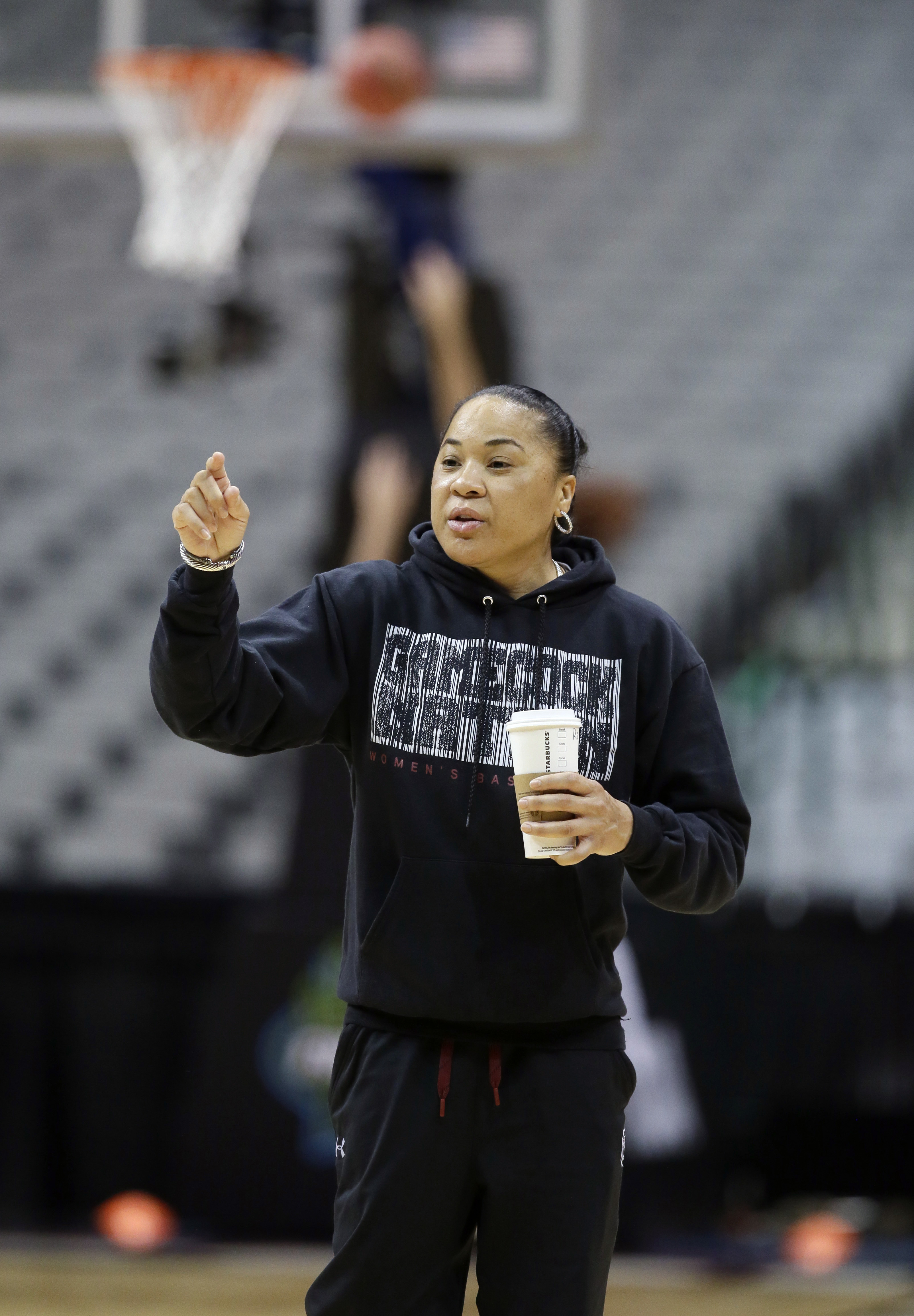 South Carolina head coach Dawn Stanley gives direction to her players during a practice session for the women's NCAA Final Four college basketball tournament, Thursday, March 30, 2017, in Dallas. South Carolina plays Stanford on Friday. (AP Photo/LM Otero