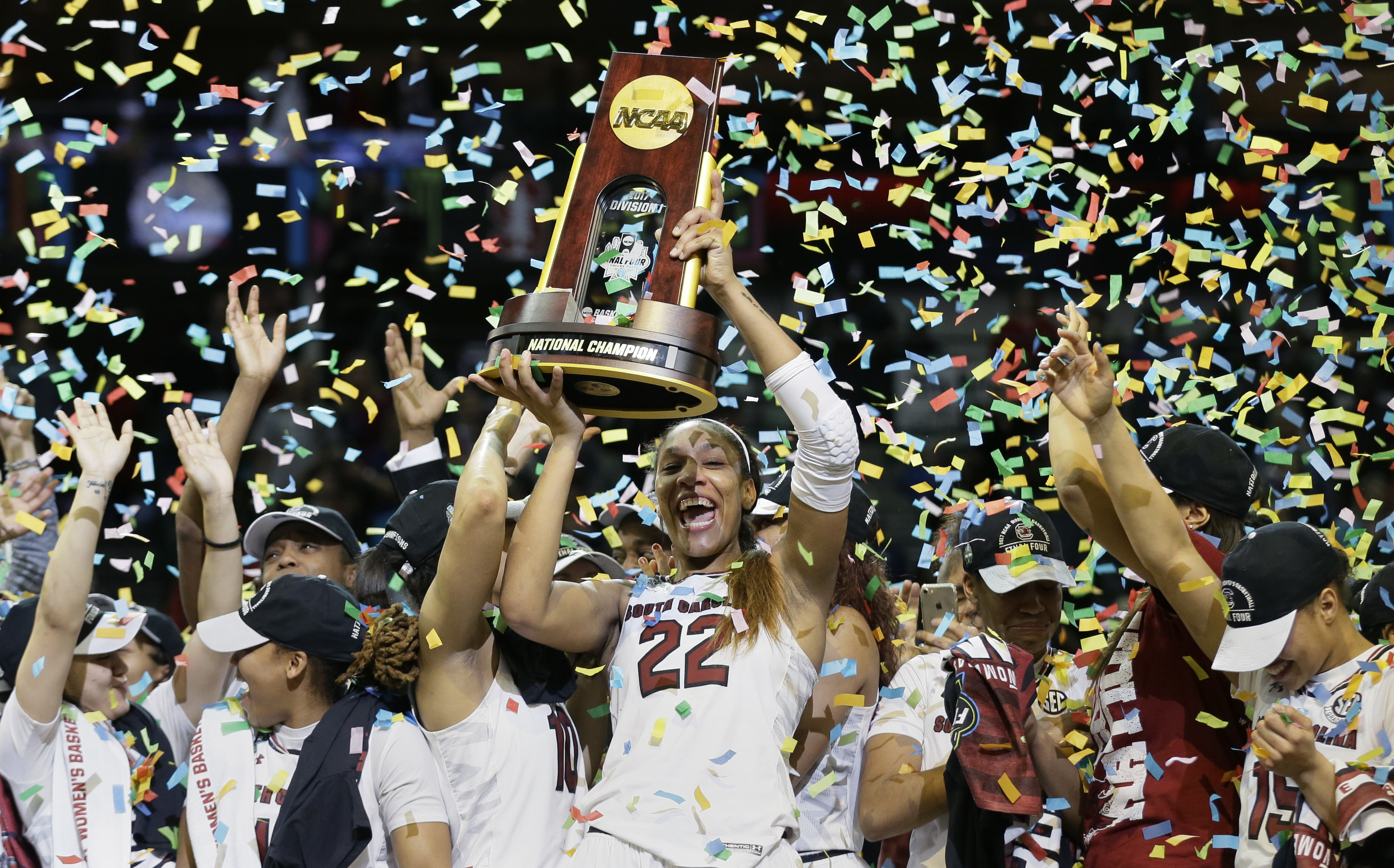 South Carolina forward A'ja Wilson (22) holds the trophy as she and her teammates celebrate a win over Mississippi State in the final of NCAA women's Final Four college basketball tournament, Sunday, April 2, 2017, in Dallas. South Carolina won 67-55. (AP