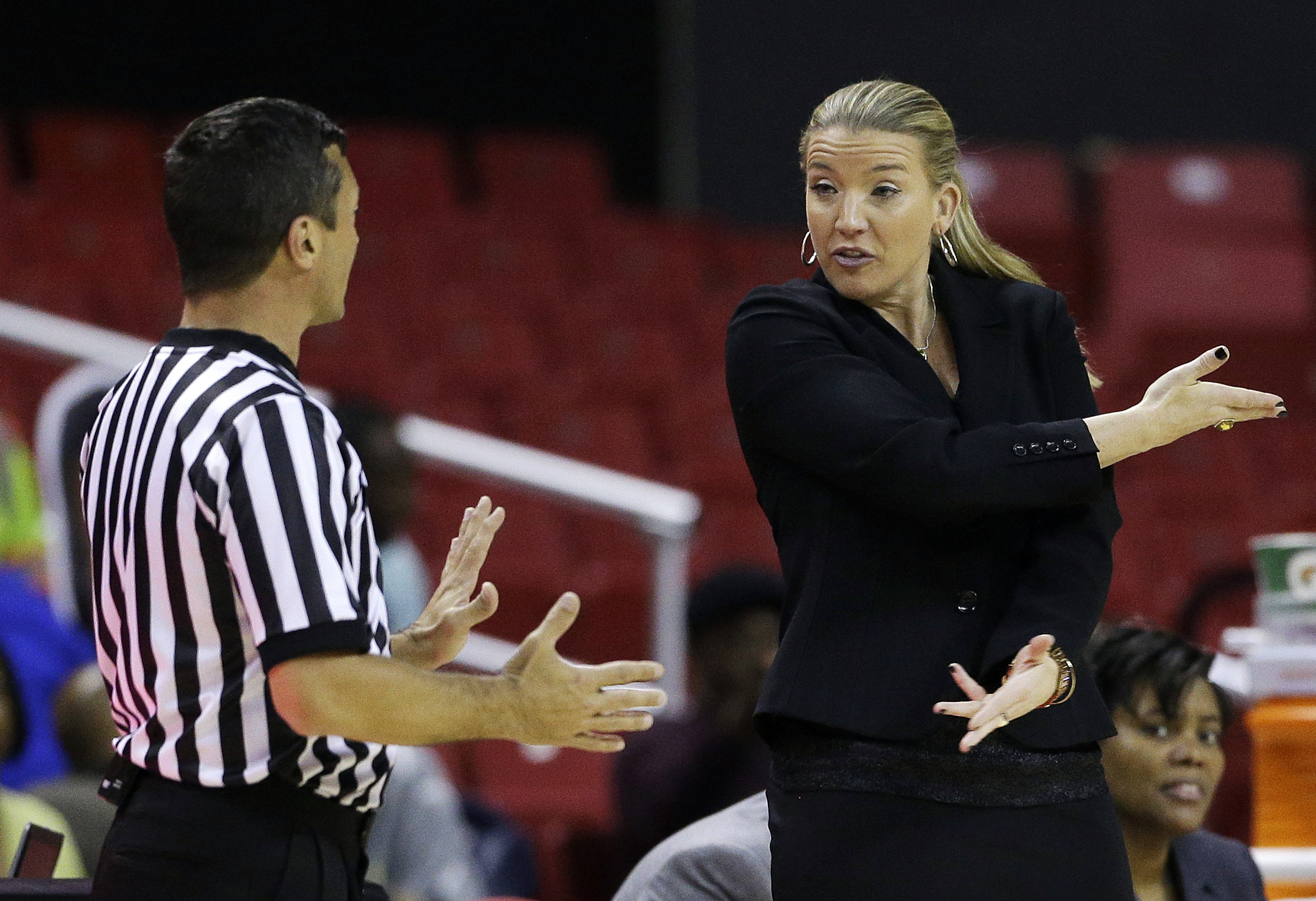 Siena head coach Ali Jaques, right, speaks with an official in the second half of an NCAA college basketball game against Maryland in College Park, Md., Monday, Dec. 9, 2013. (AP Photo/Patrick Semansky)