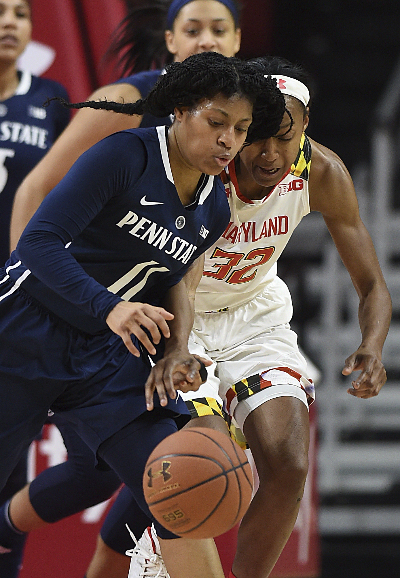 Penn State's Teniya Page, left, recovers a loose ball ahead of Maryland's Shatori Walker-Kimbrough during the second half of an NCAA college basketball game, Wednesday, Jan. 11, 2017, in College Park, Md. Maryland won 89-83. (AP Photo/Gail Burton)