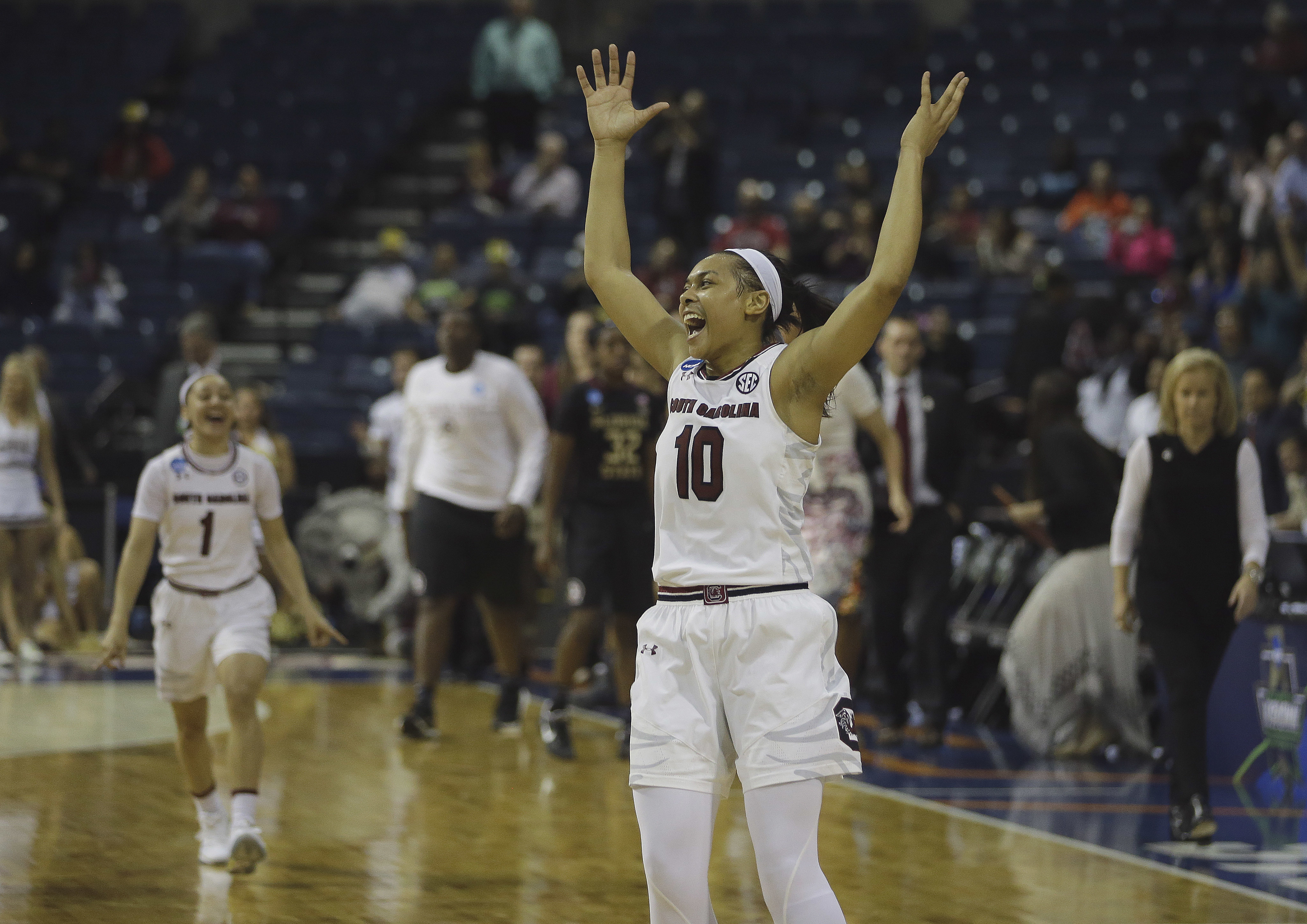 South Carolina guard Allisha Gray celebrates as the final buzzer sounds and the Gamecocks beat Florida State, 71-64, in a regional final game of the women's NCAA college basketball tournament, Monday, March 27, 2017, in Stockton, Calif. (AP Photo/Rich Ped