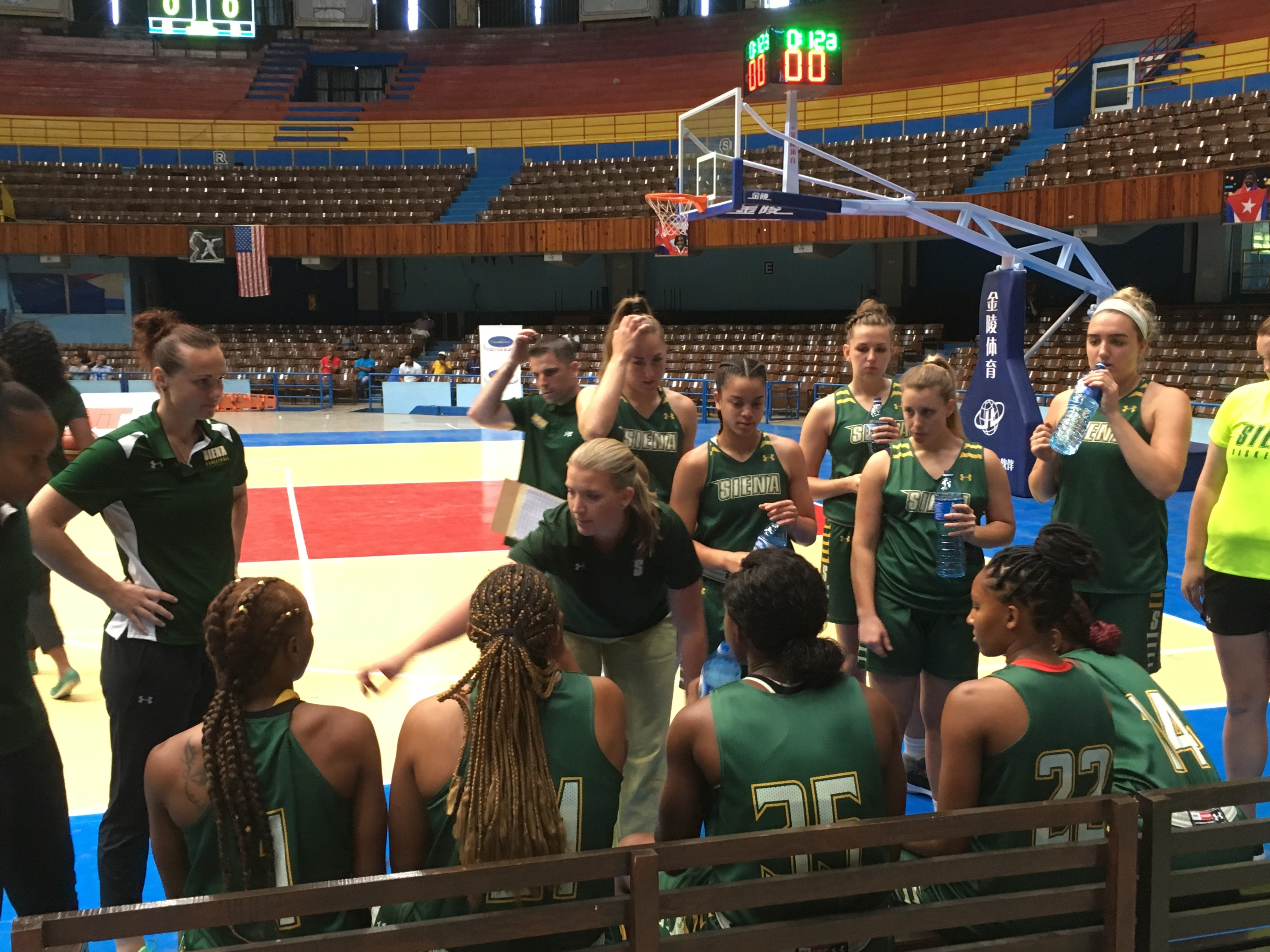 This photo taken Aug. 15, 2017, shows Siena women's coach Ali Jaques talking with her team before a game against the Cuban national team at Coliseo de la Ciudad Deportiva in Havana, Cuba. Siena played three games against the Cuban national team, plus host