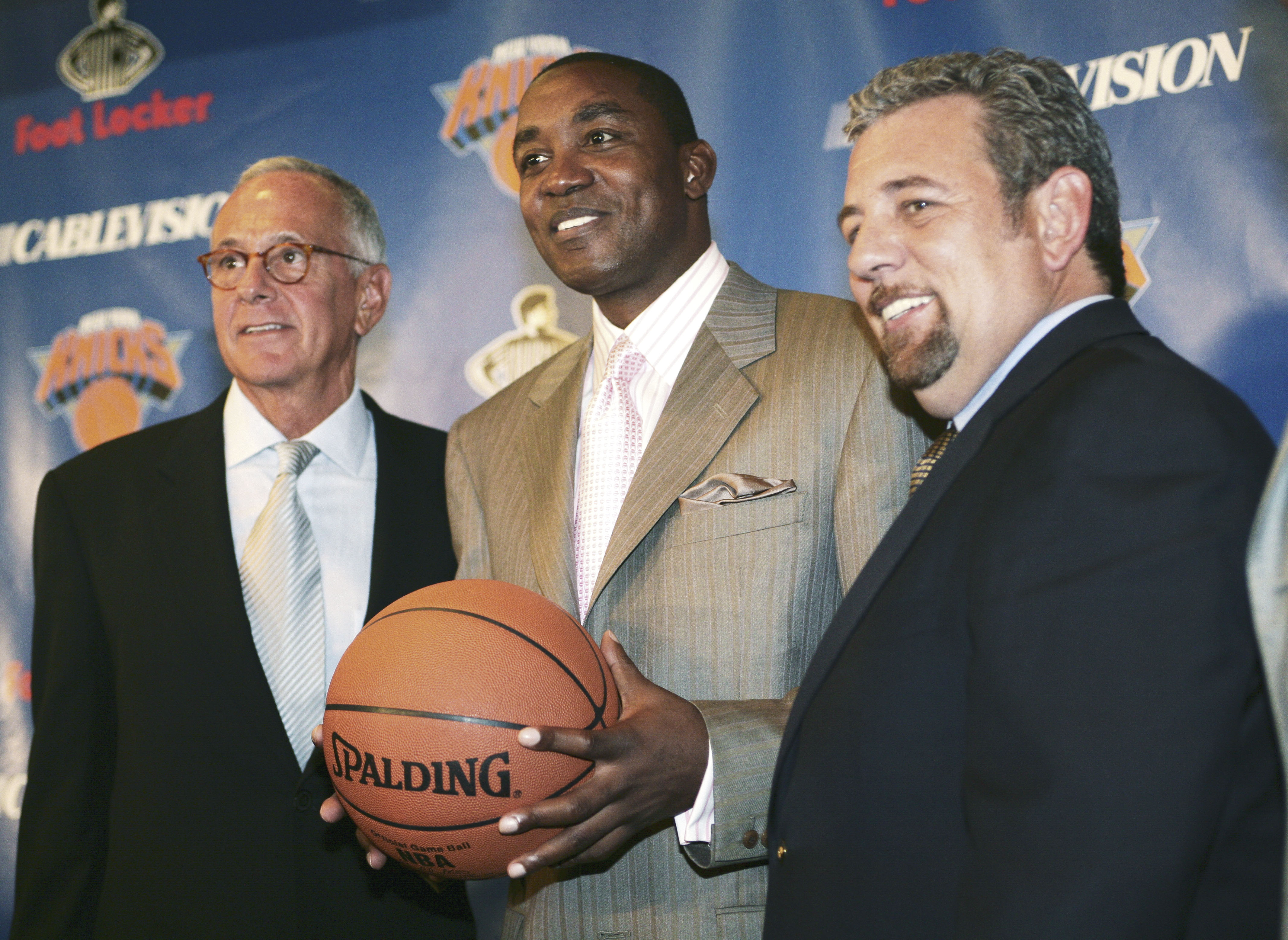NEW YORK - JULY 28:  Larry Brown (L), new head coach of the New York Knicks, Isiah Thomas (C), President of Basketball Operations and Knicks owner James Dolan stand together during a press conference at Madison Square Garden on July 28, 2005 in New York C