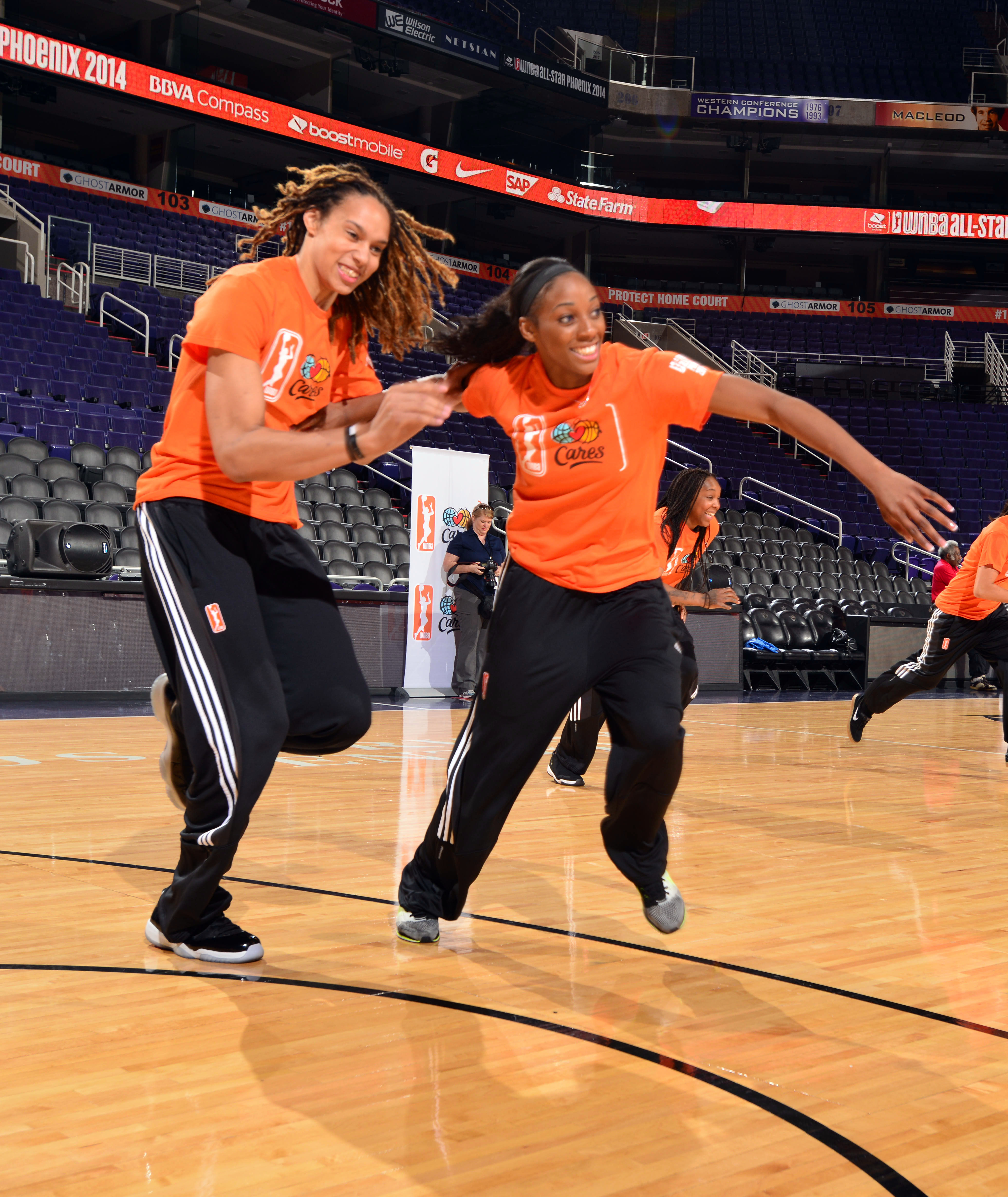 PHOENIX, AZ - JULY 18: Brittney Griner #42 of the Phoenix Mercury and Glory Johnson #25 of the Tulsa Shock run during a WNBA All-Star Cares event on July 18, 2014 at US Airways Center in Phoenix, Arizona. (Photo by Barry Gossage/NBAE via Getty Images)