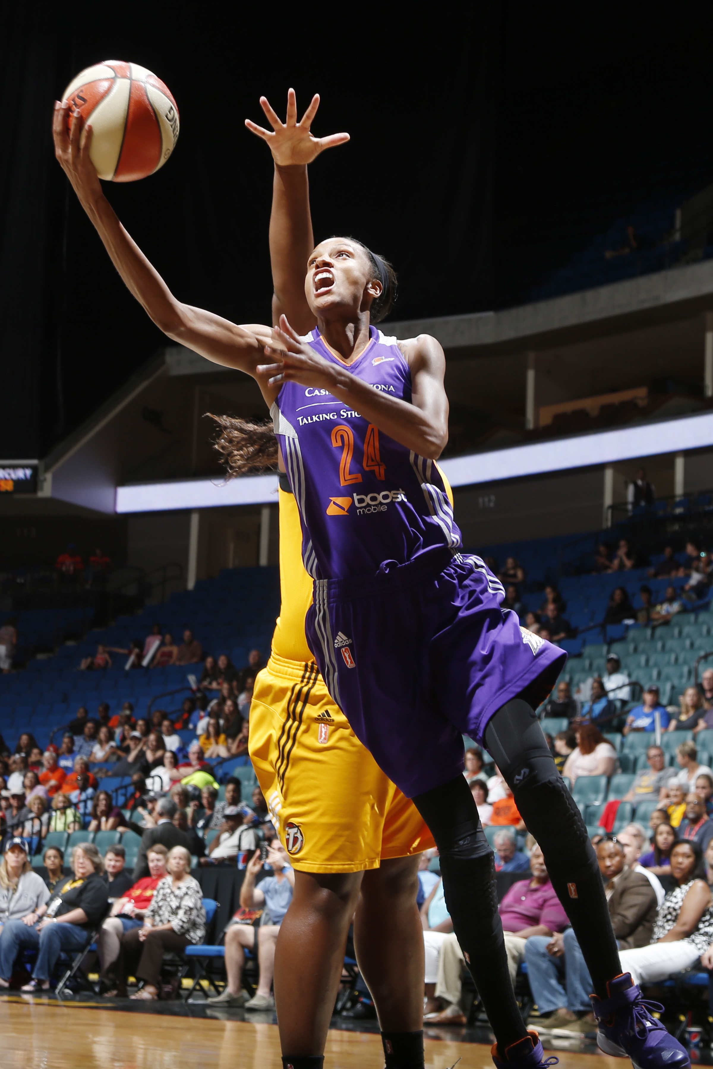 TULSA, OK - JULY 30:  DeWanna Bonner #24 of the Phoenix Mercury goes up for a shot against the Tulsa Shock on July 30, 2015 at the BOK Center in Tulsa, Oklahoma.  (Photo by Shane Bevel/NBAE via Getty Images)