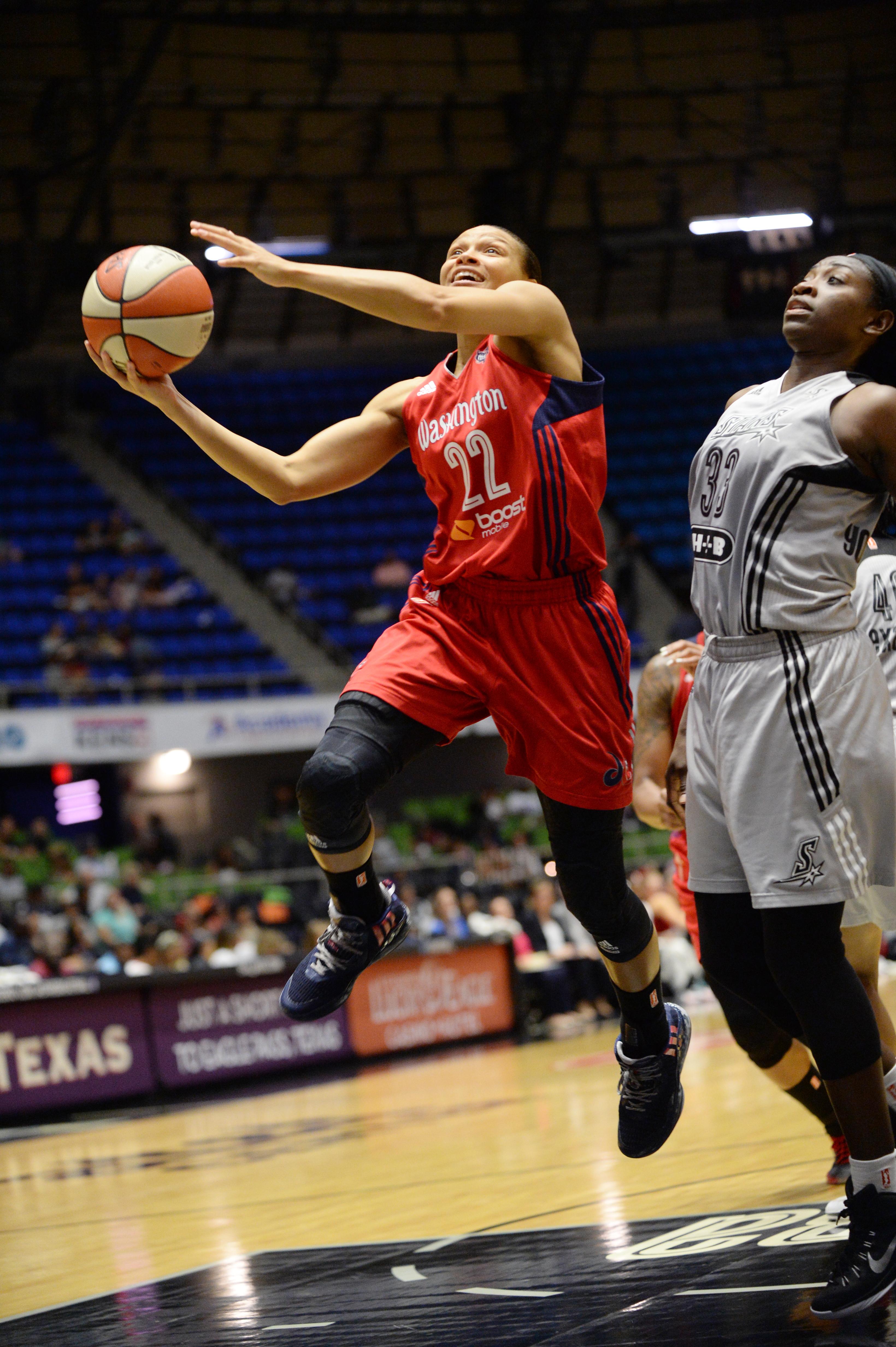 SAN ANTONIO - JULY 31: Armintie Herrington #22 of the Washington Mystics shoots the ball against the San Antonio Stars in the WNBA game on July 31, 2015 at the Freeman Coliseum in San Antonio, Texas.