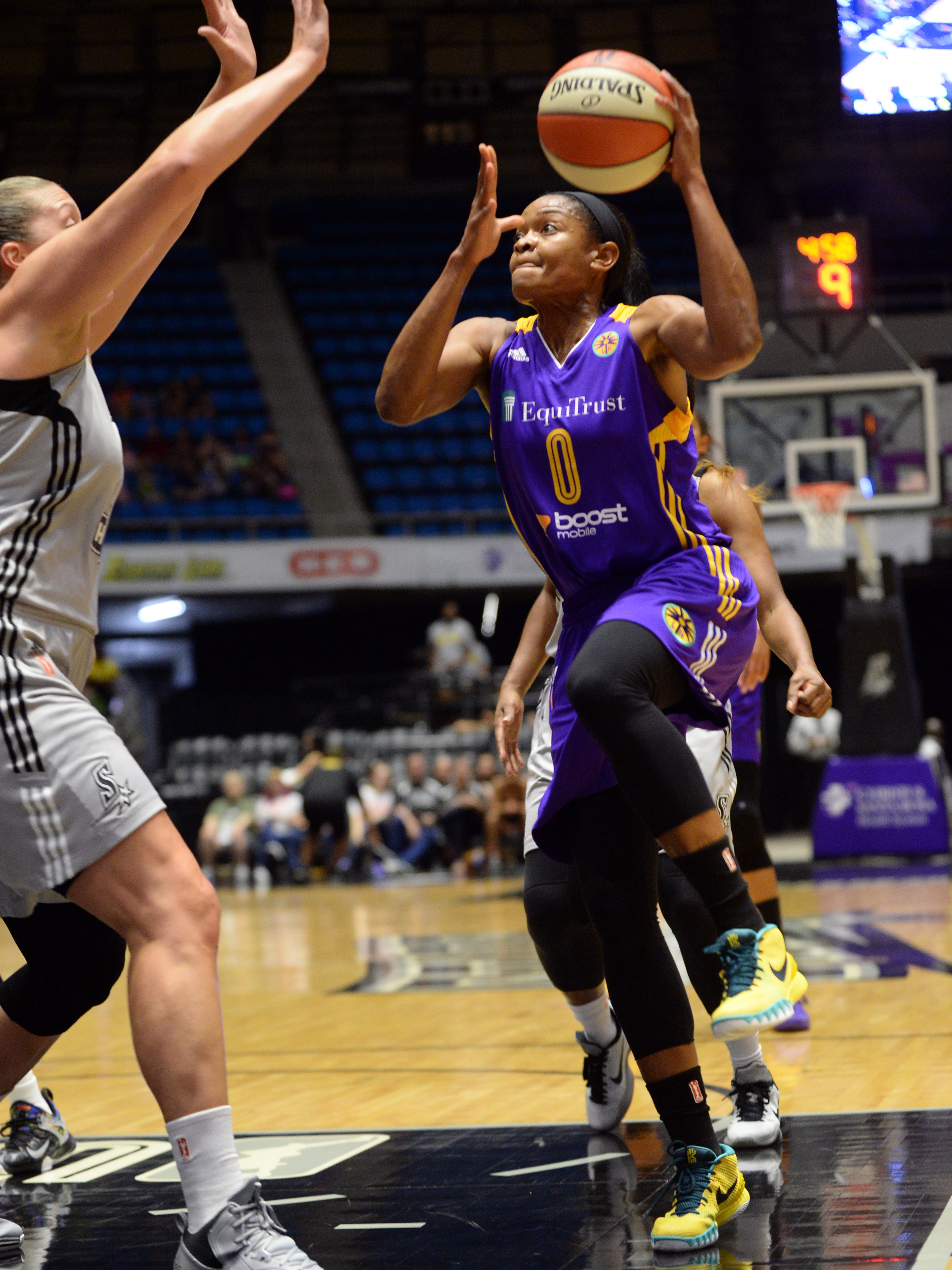 SAN ANTONIO - AUGUST 2: Alana Beard #0 of the Los Angeles Sparks drives to the basket against the San Antonio Stars on August 2, 2015 at the Freeman Coliseum in San Antonio, Texas.