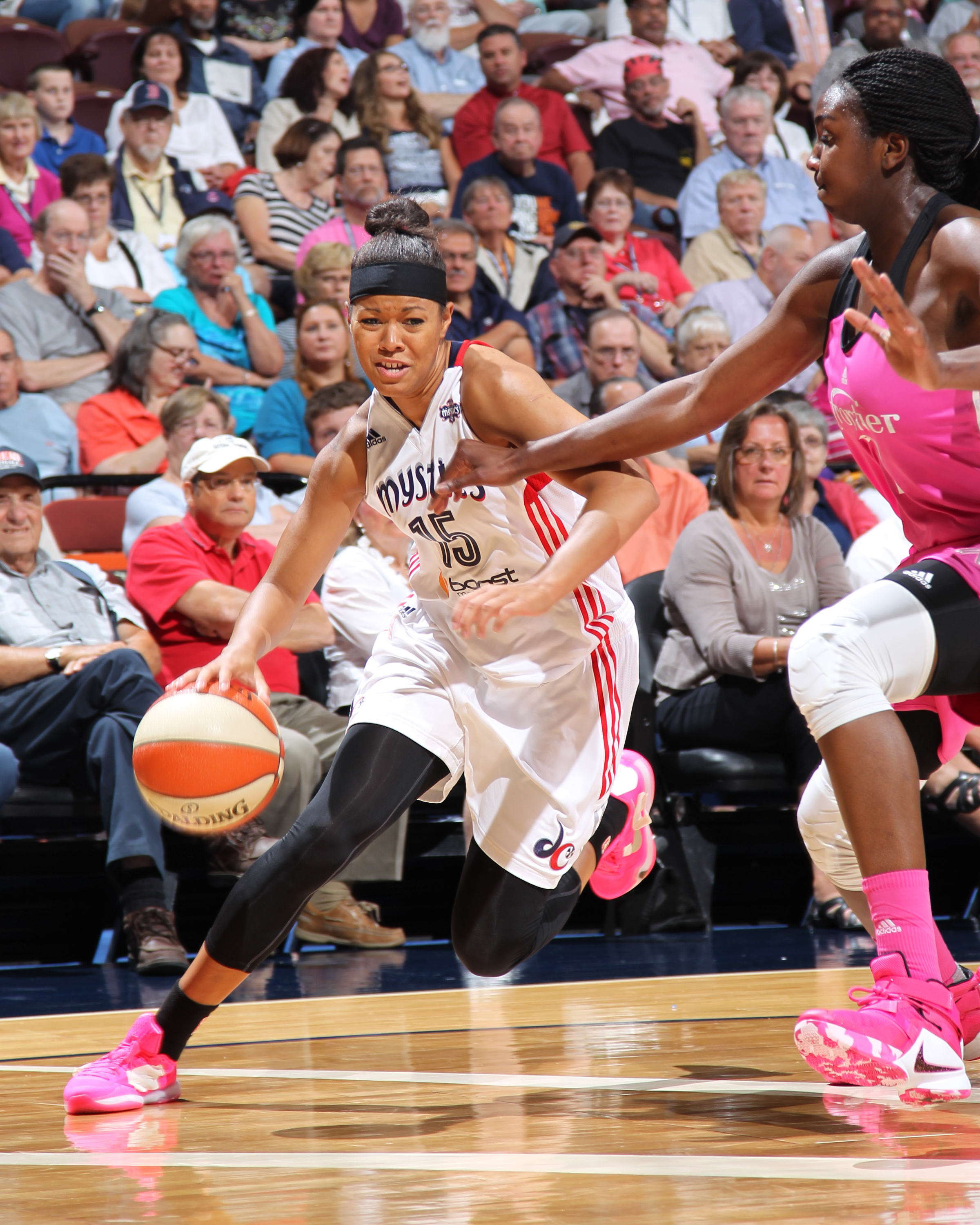 UNCASVILLE, CT - AUGUST 7:  Natasha Cloud #15 of the Washington Mystics handles the ball against the Connecticut Sun on August 7, 2015 at the Mohegan Sun Arena in Uncasville, Connecticut. (Photo by Chris Marion/NBAE via Getty Images)