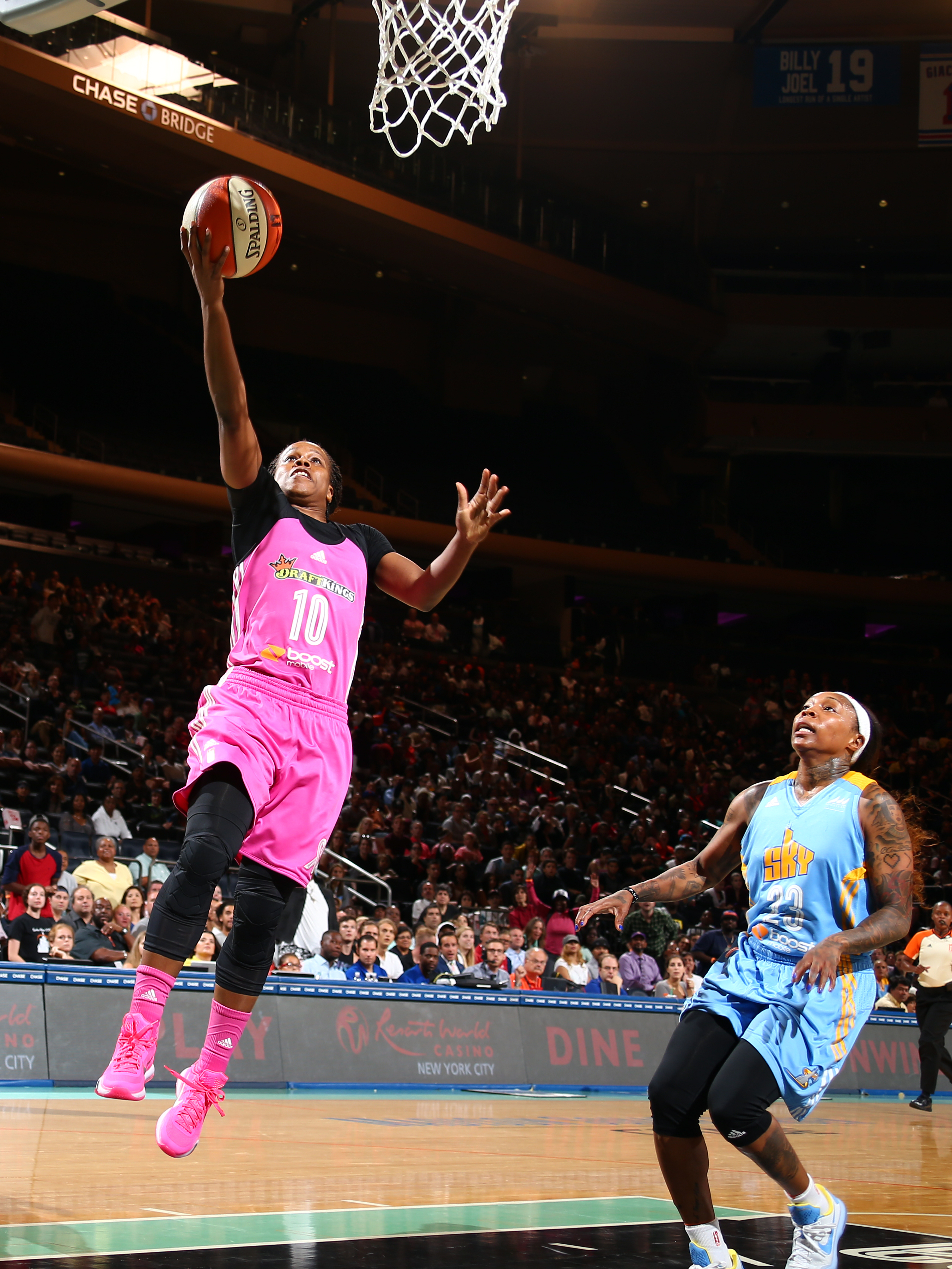 NEW YORK, NY - AUGUST 11: Epiphanny Prince #10 of the New York Liberty goes for the lay up against Cappie Pondexter #23 of the Chicago Sky on August 11, 2015 at Madison Square Garden, New York City , New York.  (Photo by Nathaniel S. Butler/NBAE via Getty