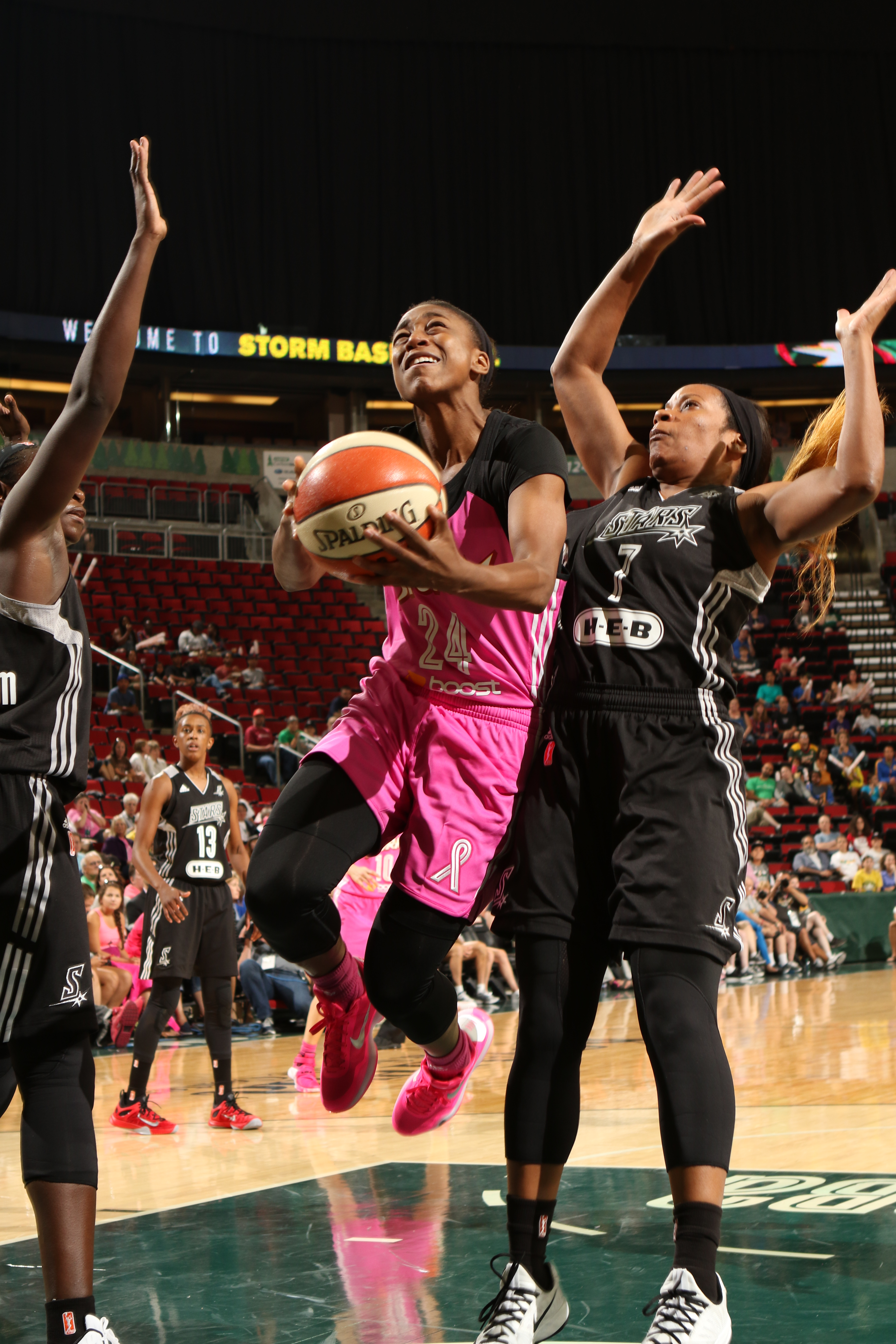 SEATTLE, WA - AUGUST 16: Jewell Loyd #24 of the Seattle Storm goes for the lay up against Jia Perkins #7 of the San Antonio Stars on August 16, 2015 at Key Arena in Seattle, Washington. (Photo by Joshua Huston/NBAE via Getty Images)