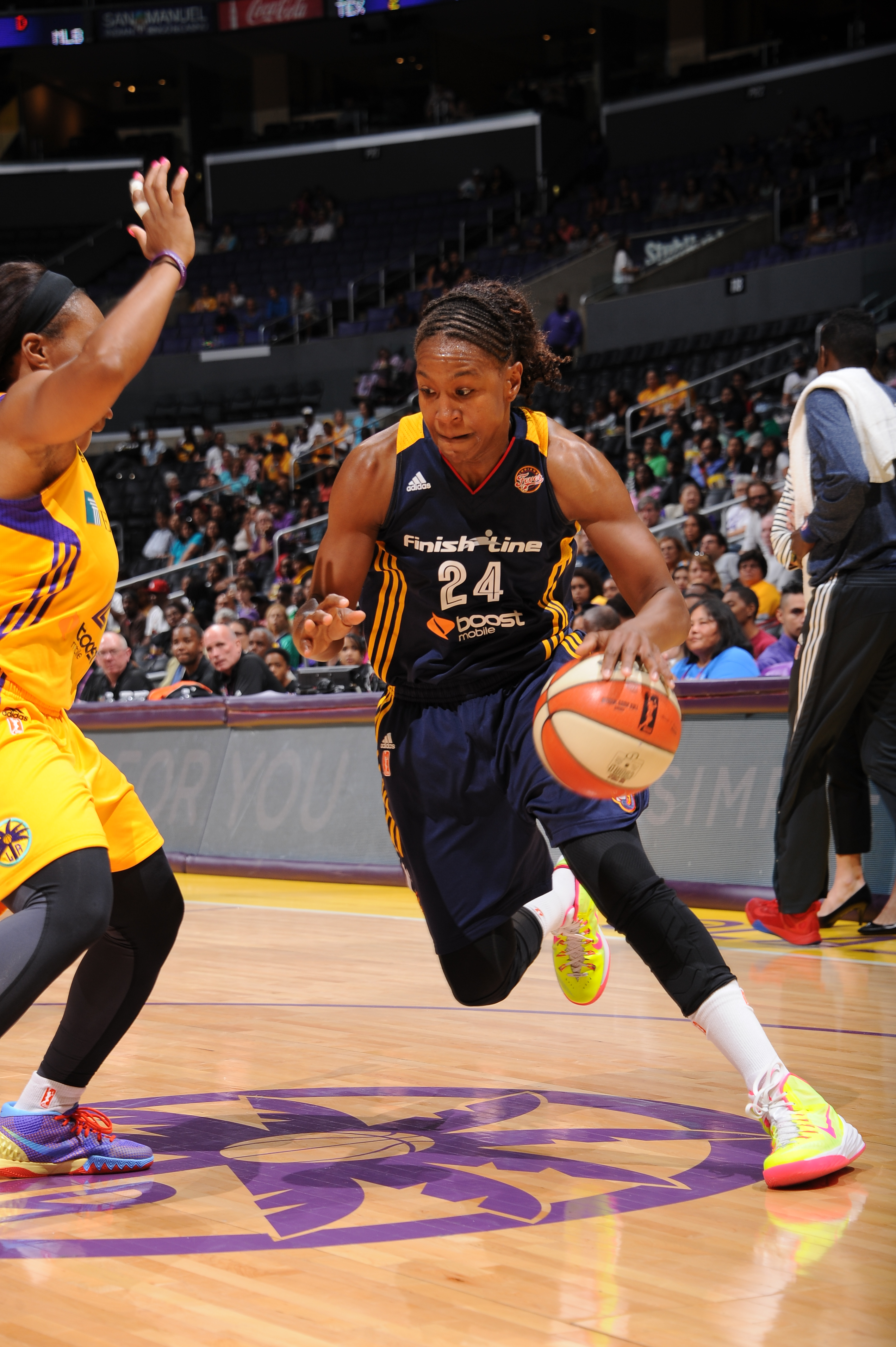 LOS ANGELES, CA - AUGUST 18: Tamika Catchings #24 of the Indiana Fever drives to the basket against the Los Angeles Sparks on August 18, 2015 at STAPLES Center in Los Angeles, California.  (Photo by Juan Ocampo/NBAE via Getty Images)
