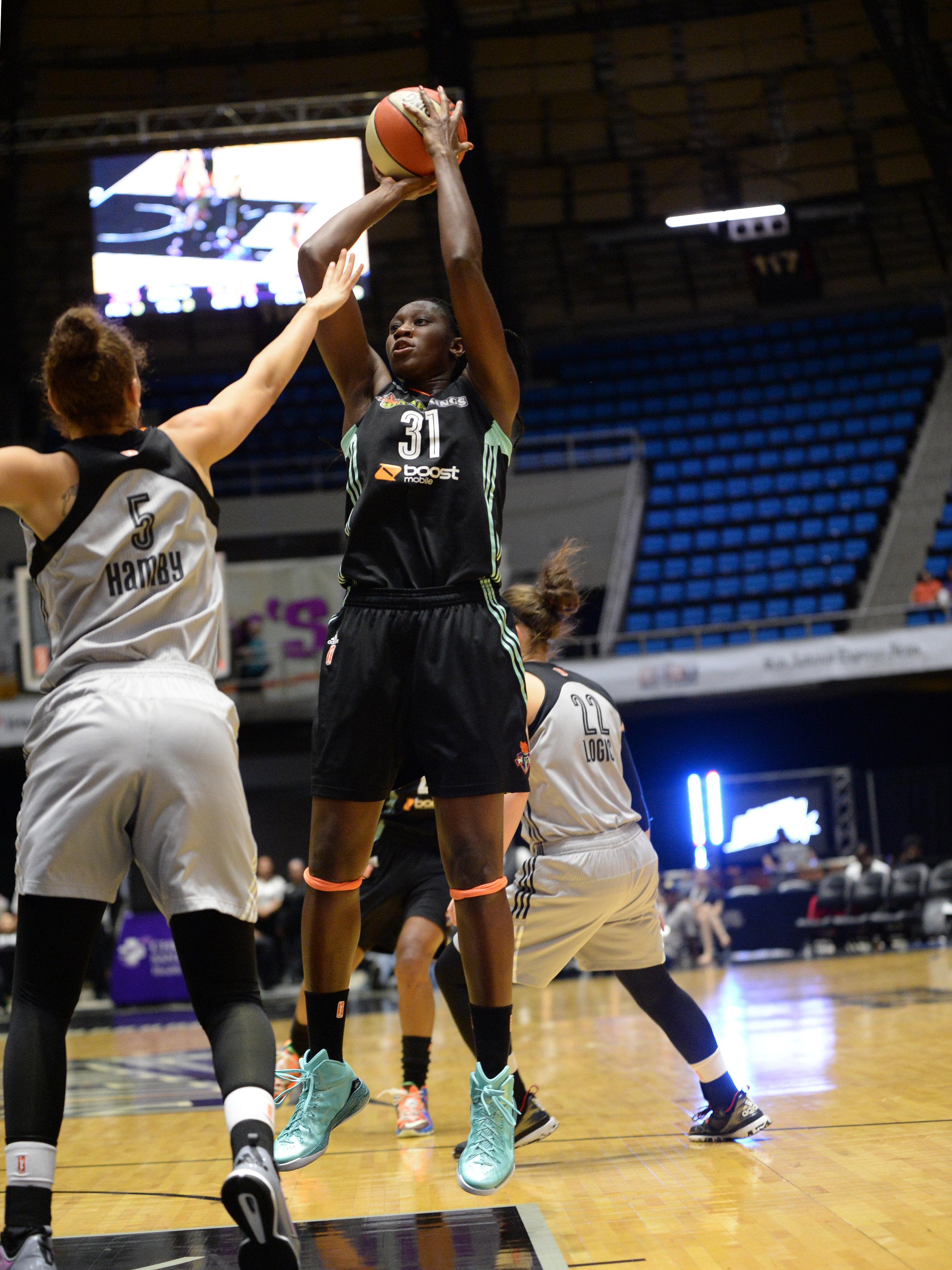 SAN ANTONIO - AUGUST 19: Tina Charles #31 of the New York Liberty shoots the ball against the San Antonio Stars on August 19, 2015 at the Freeman Coliseum in San Antonio, Texas.