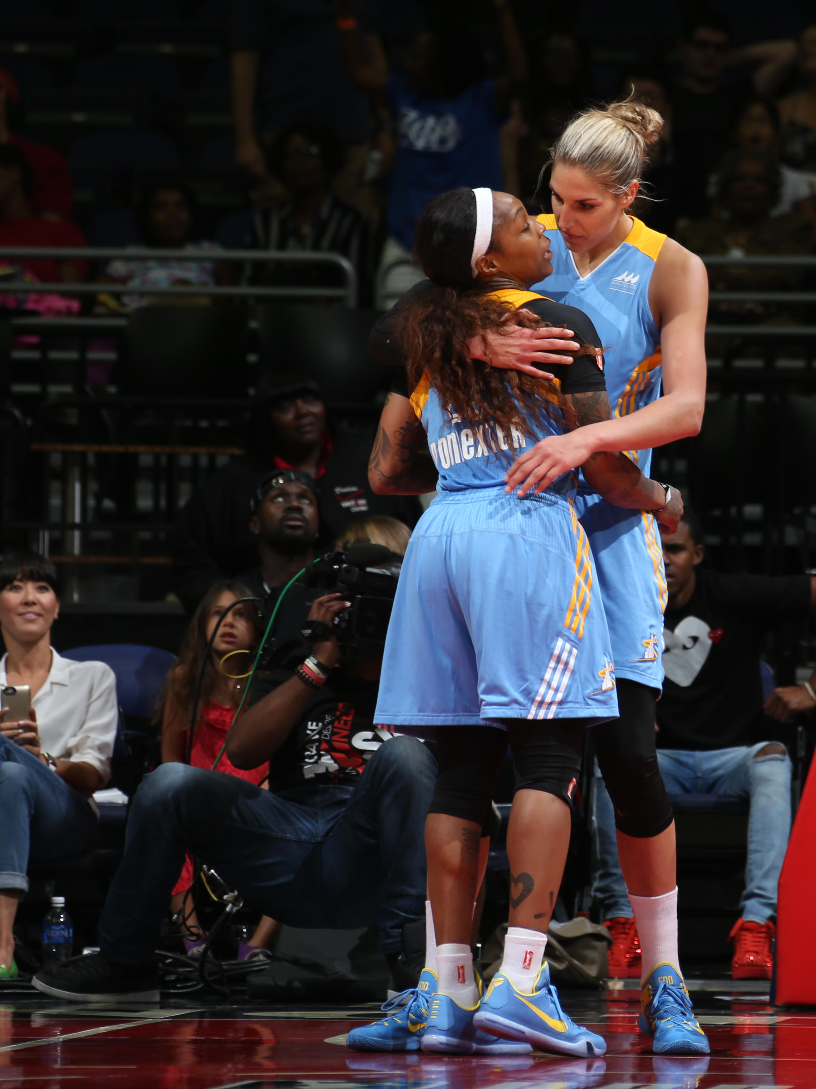 WASHINGTON, DC - AUGUST 23: Elena Delle Donne #11 of the Chicago Sky hugs Cappie Pondexter #23 of the Chicago Sky after a game winning play against the Washington Mystics on August 23, 2015 at the Verizon Center in Washington, DC. (Photo by Ned Dishman/NB