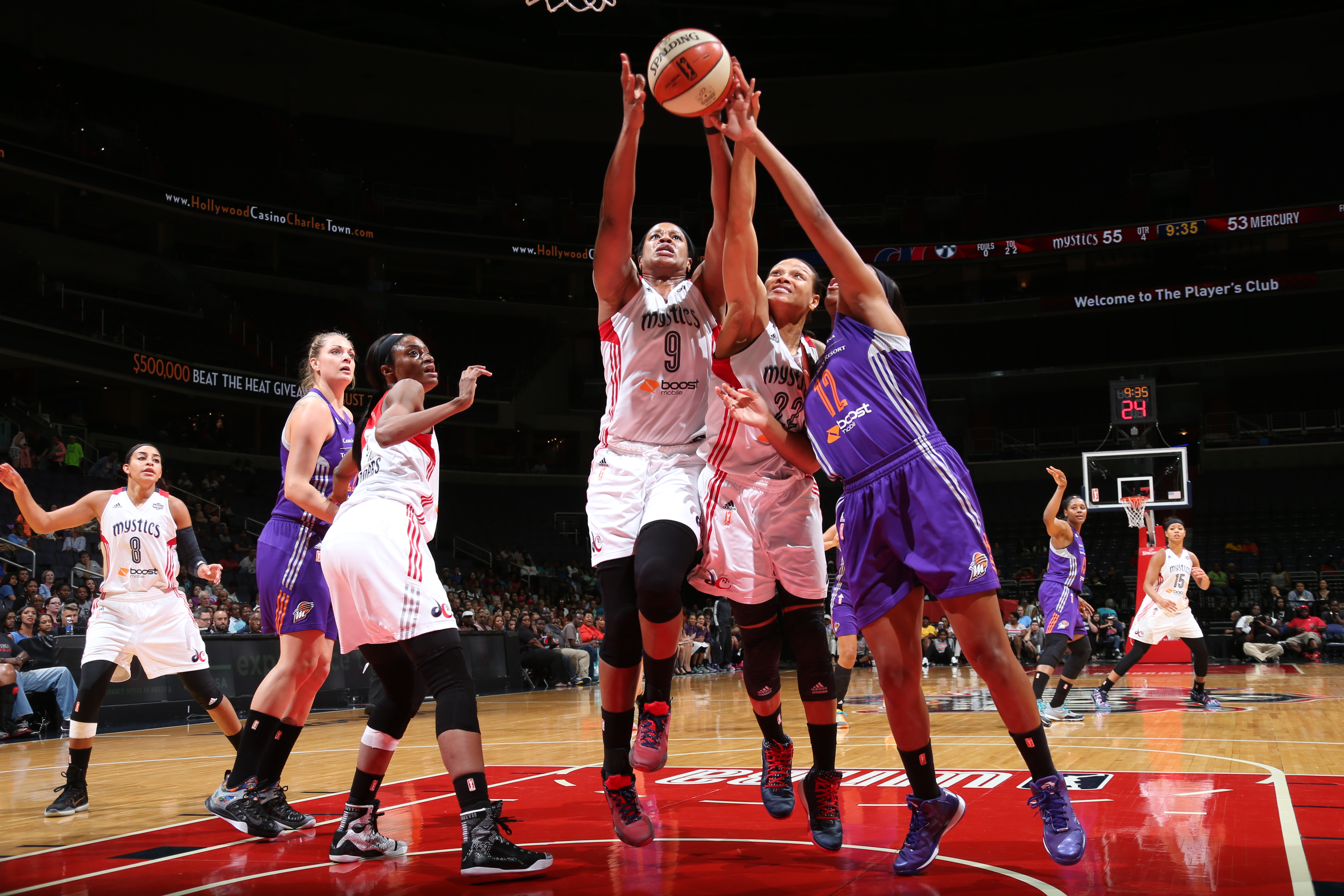 WASHINGTON, DC - AUGUST 28: Kia Vaughn #9 and Armintie Herrington #22 of the Washington Mystics battle Alex Harden #12 of the Phoenix Mercury for the rebound on August 25, 2015 at the Verizon Center in Washington, DC. (Photo by Ned Dishman/NBAE via Getty