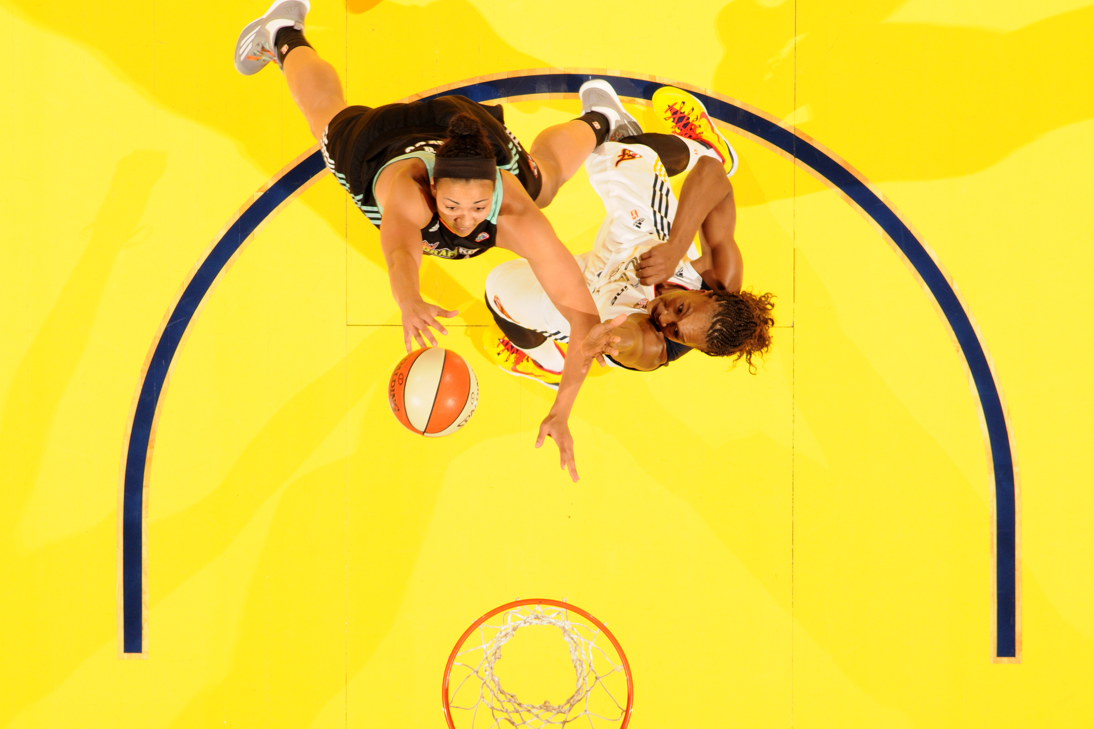 INDIANAPOLIS - SEPTEMBER 27:  Kiah Stokes #41 of the New York Liberty drives to the basket against Tamika Catchings #24 of the Indiana Fever in Game Two of the WNBA Eastern Conference Finals at Bankers Life Fieldhouse on September 27, 2015 in Indianapolis